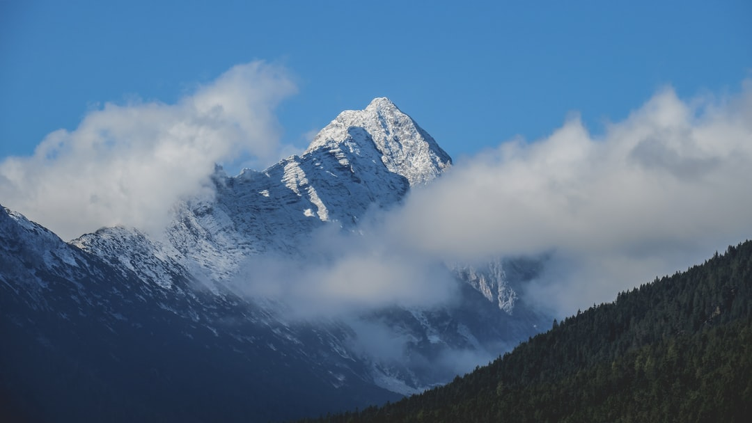 Clouds and blue sky over a mountain