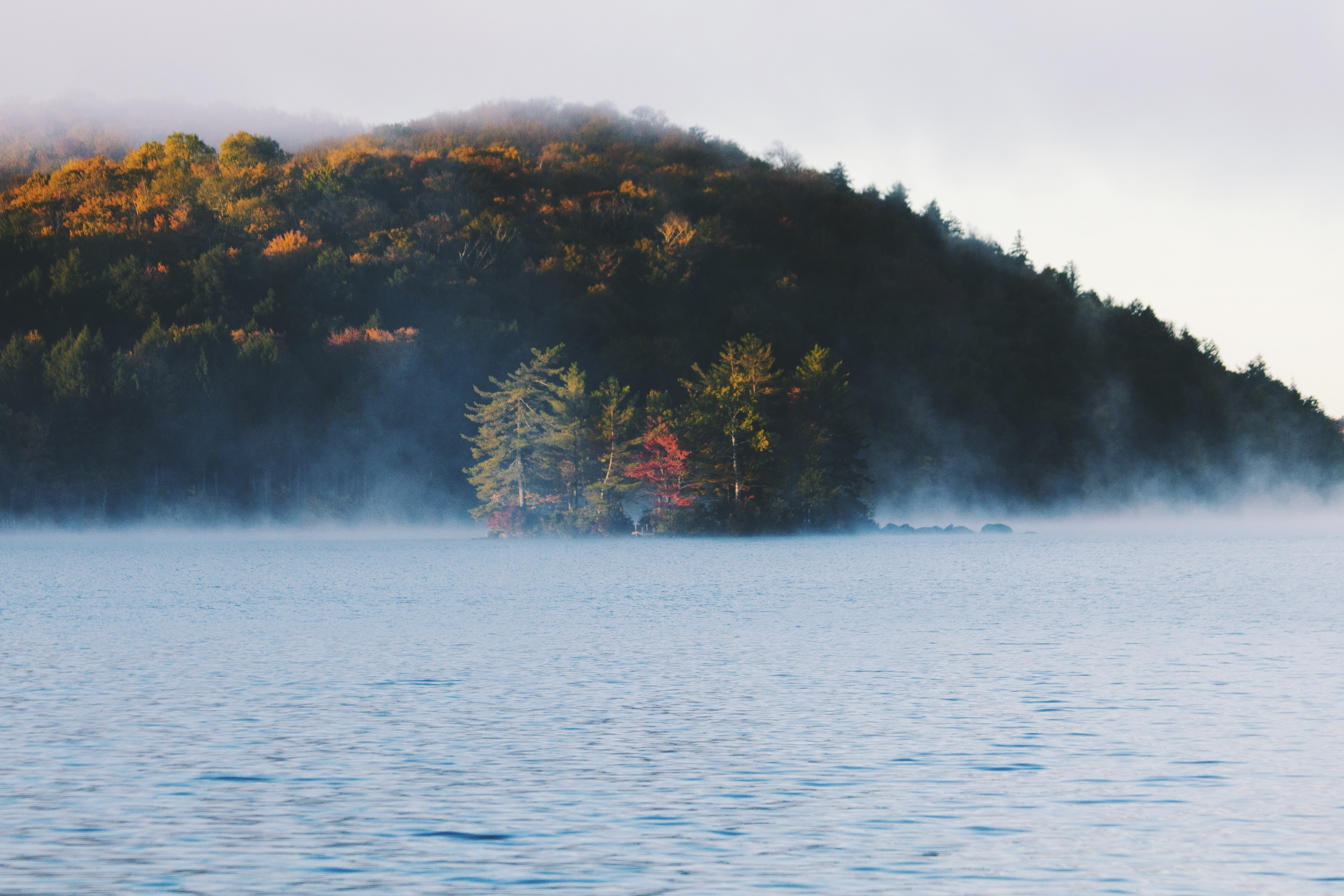 Mist rising up above the surface a quiet lake