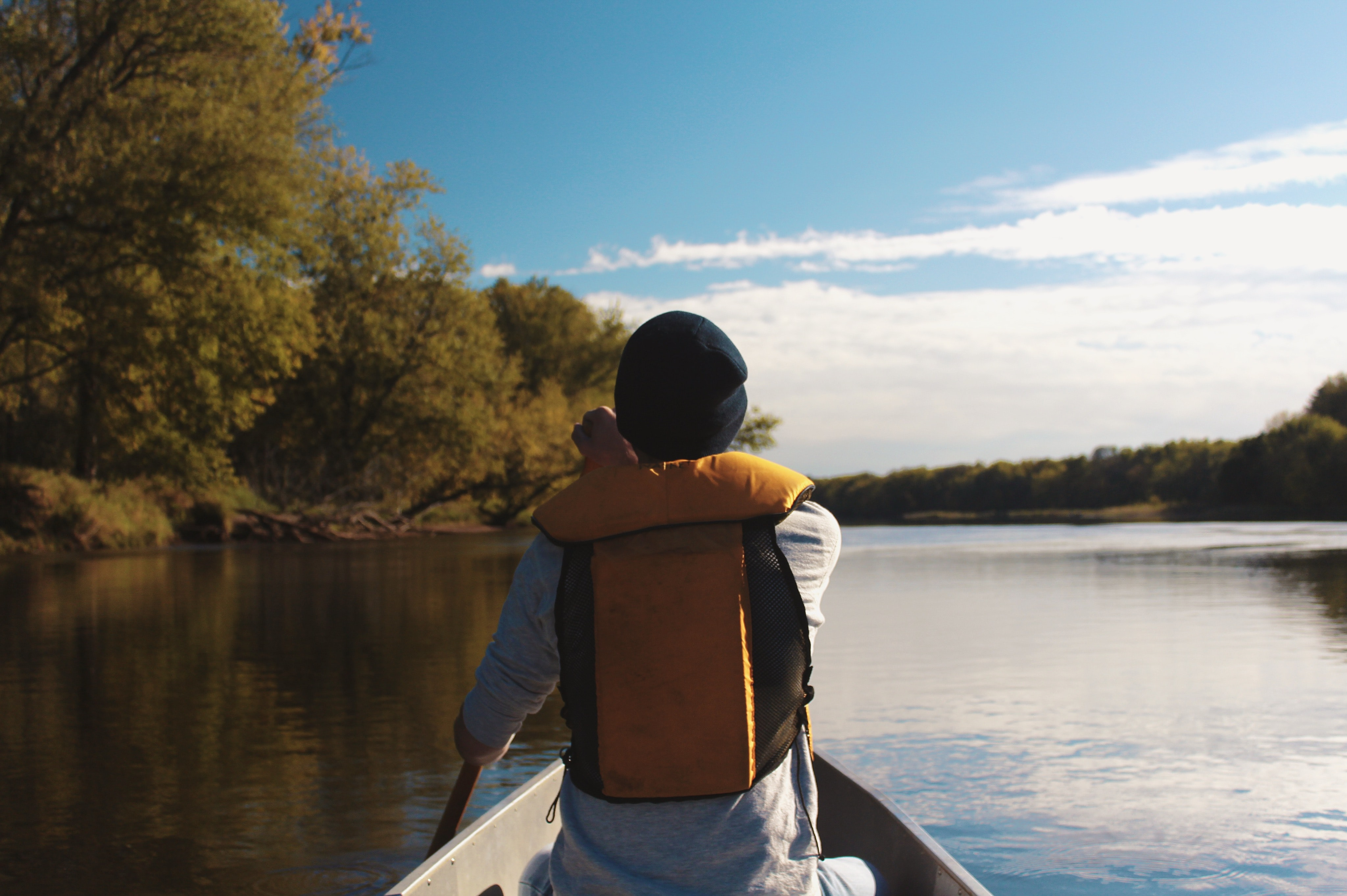 A male rowing in a canoe along the Saint Croix River in Maine