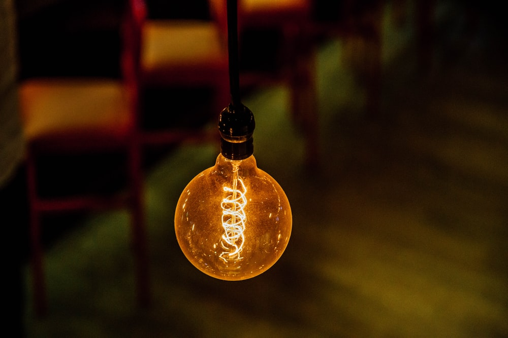 shallow focus photography of lighted bulb