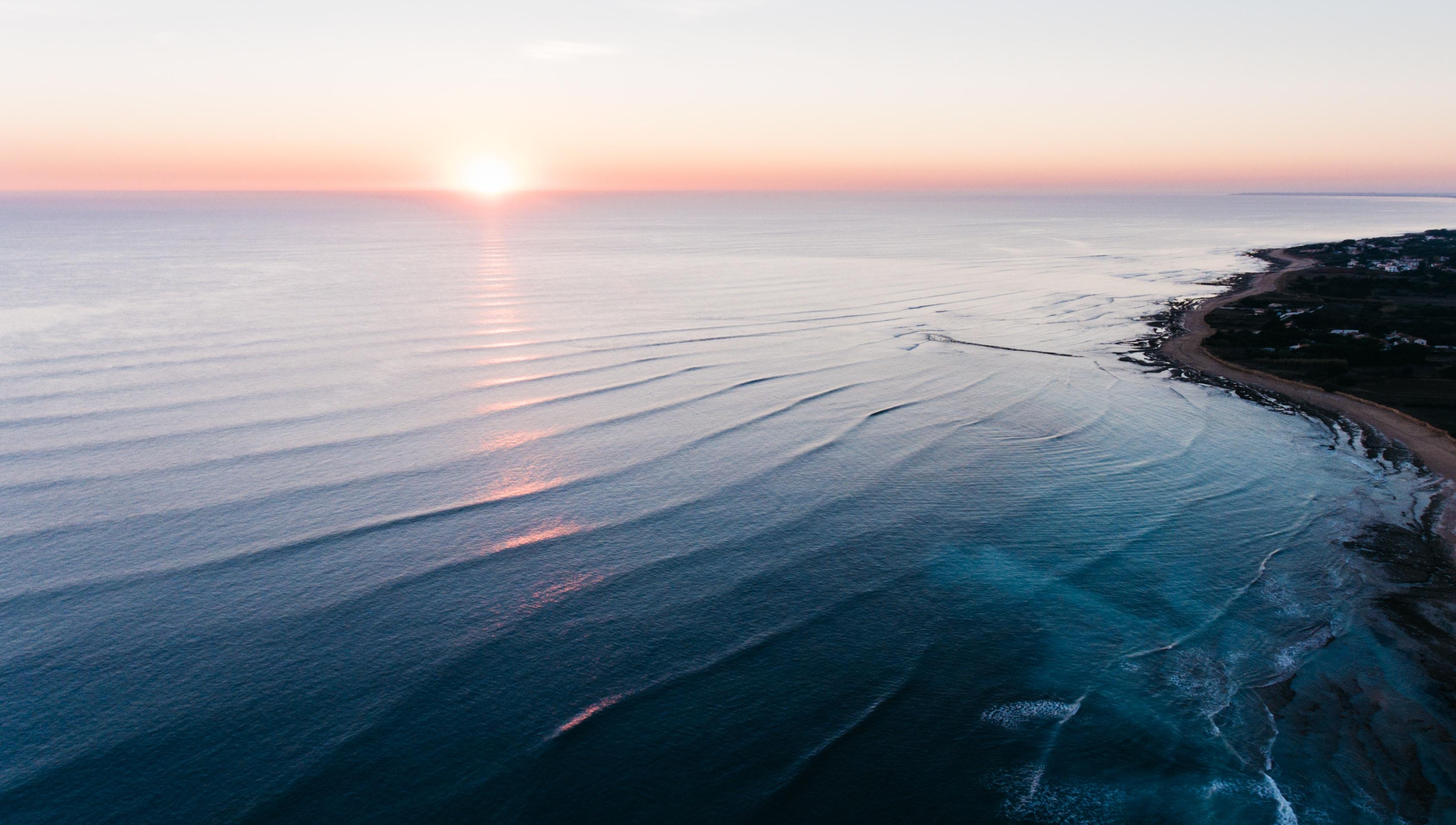 Seascape of a calm ocean coastline during sunset at Sainte-Marie-de-Ré, France