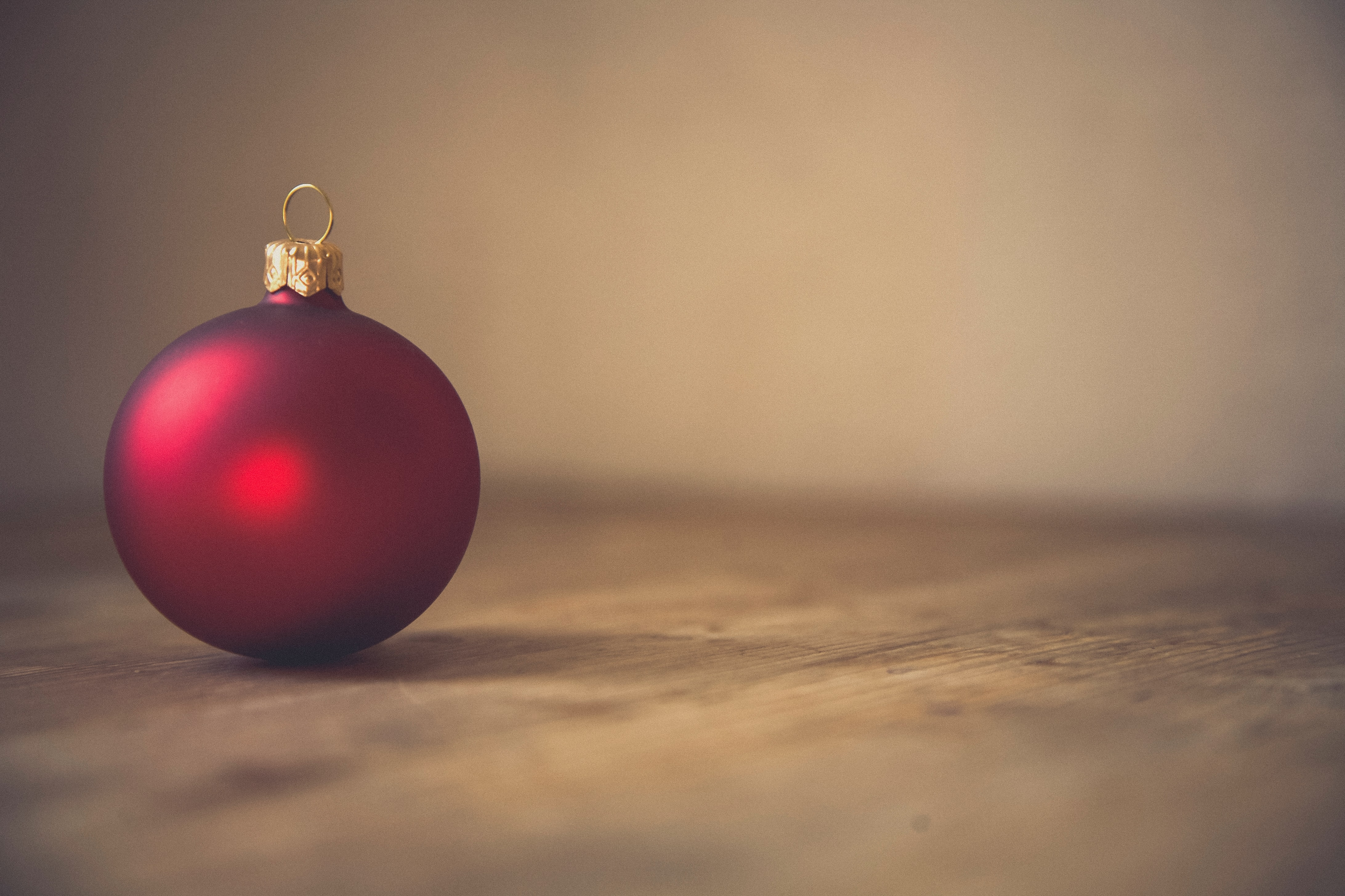 closeup photo of red ball ornament on surface