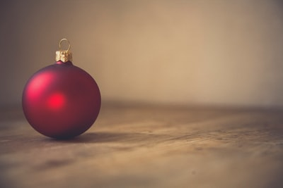 closeup photo of red ball ornament on surface xma zoom background