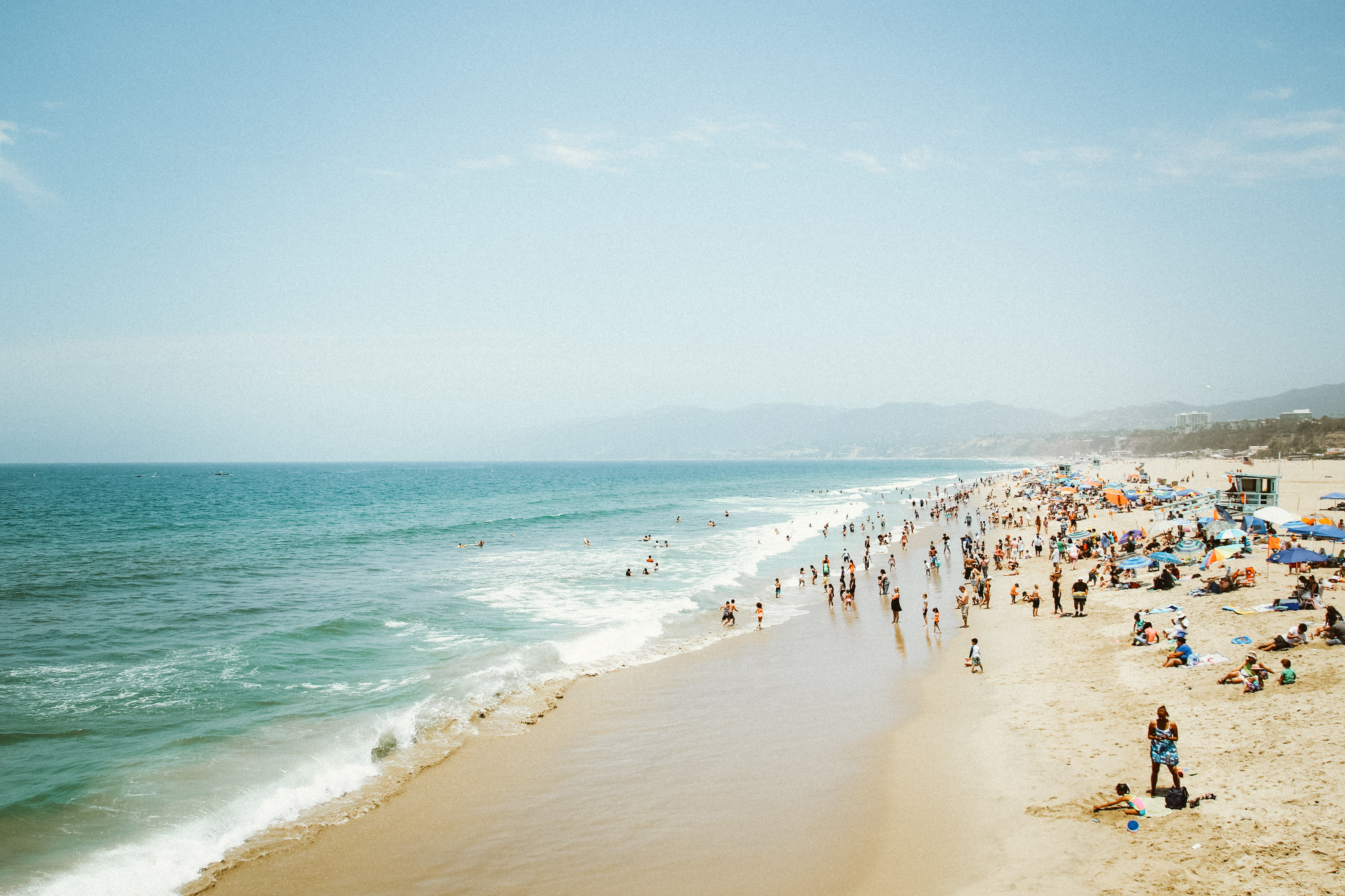 A crowded beach on a sunny day in Santa Monica