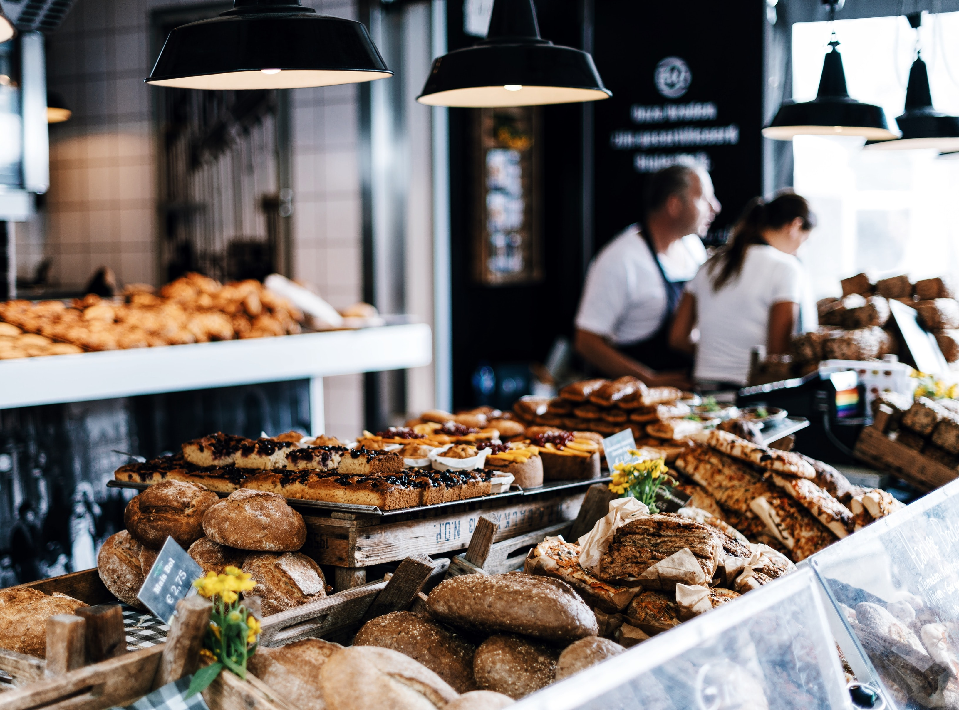 Bread and pastries on a display in a bakery