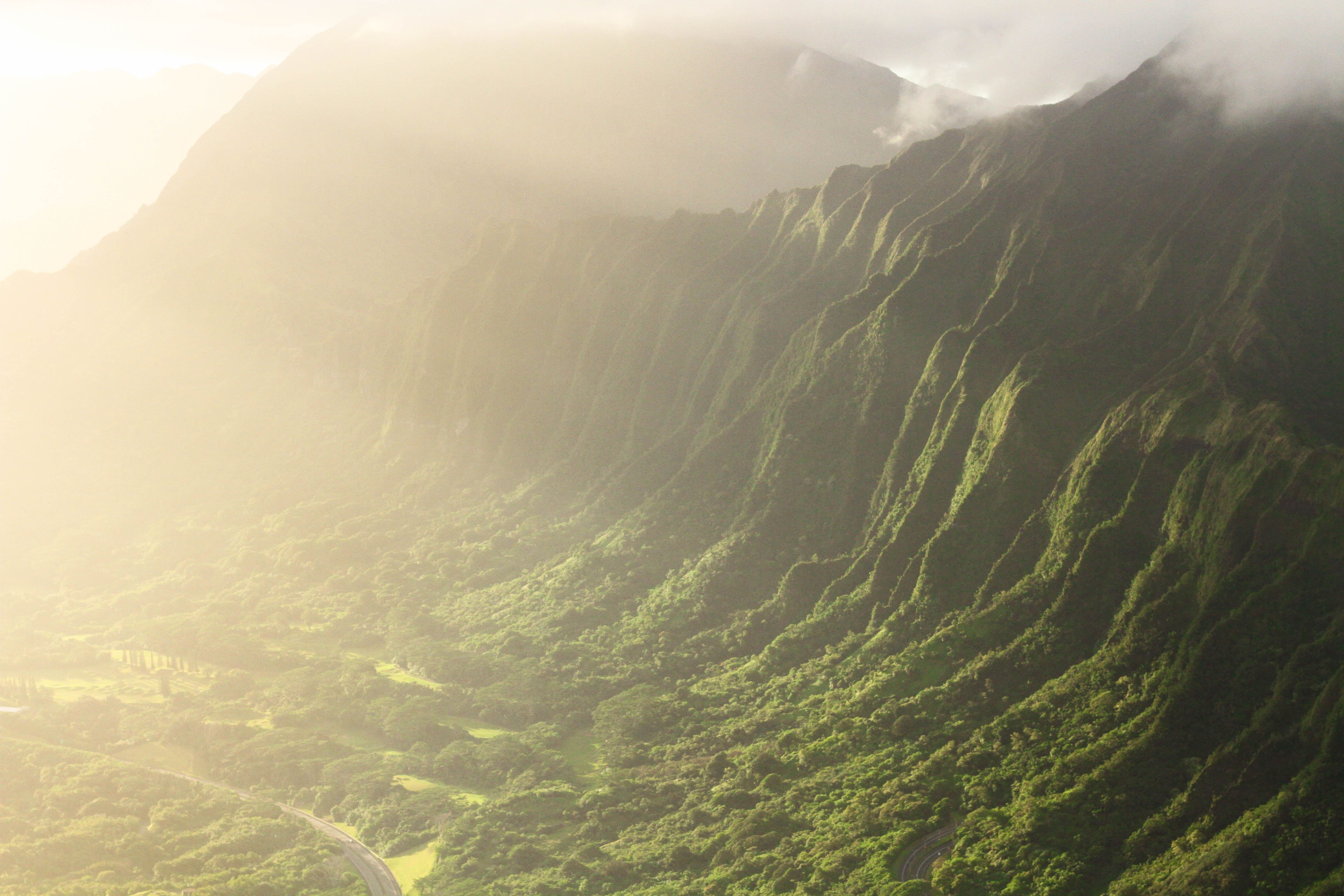 A sunrise over grassy mountains in Hawaii.
