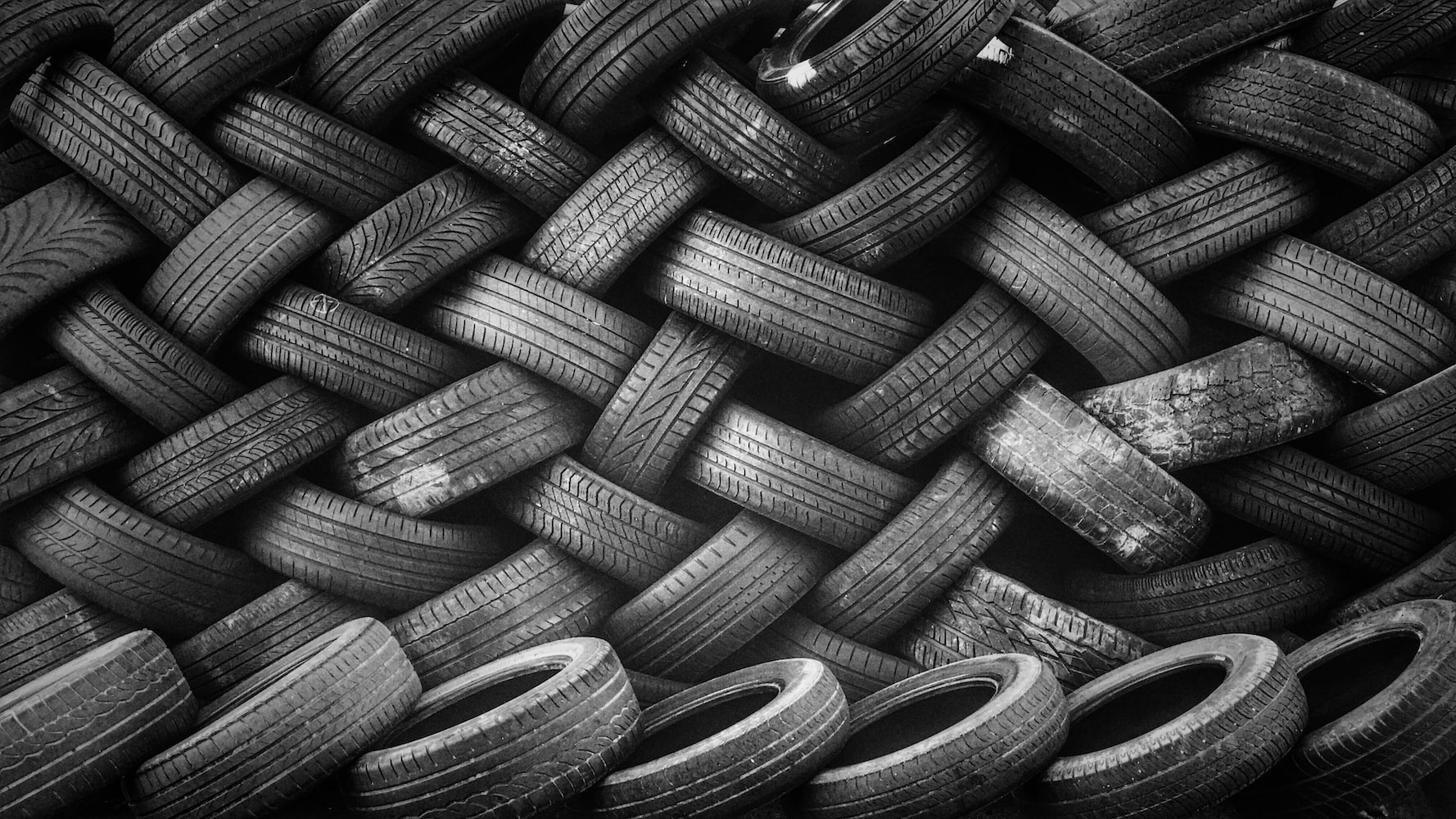 Tires piled in an interesting pattern.