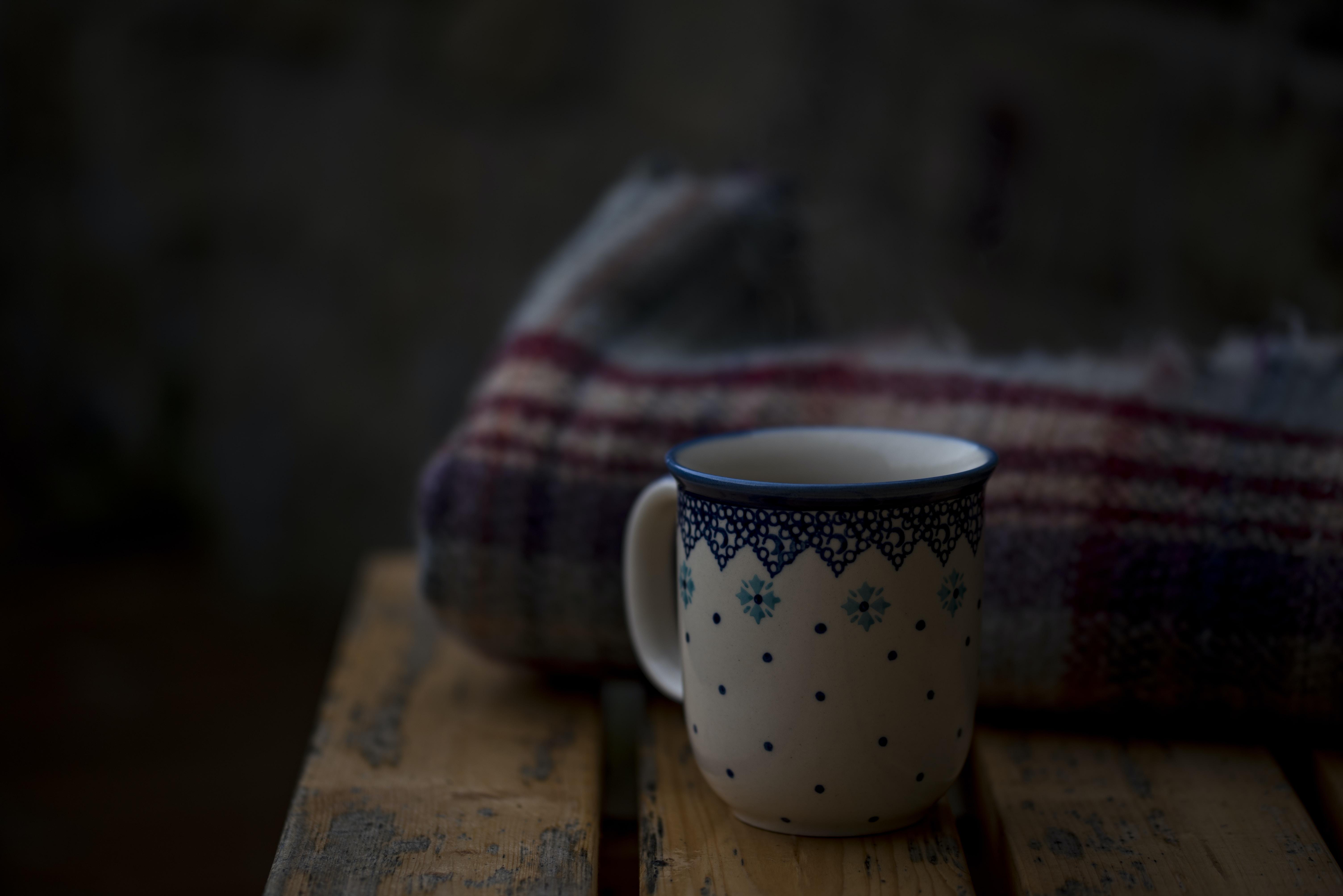 white and blue coffee mug