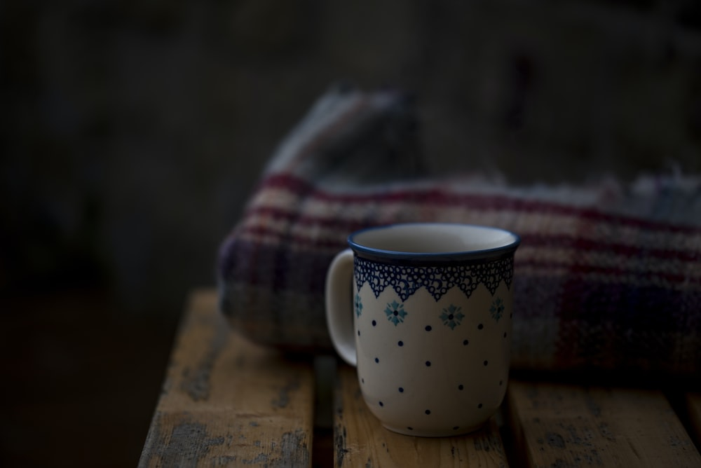 white and blue coffee mug