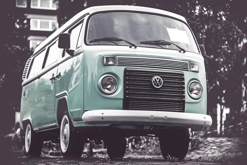 selective color photography of teal Volkswagen T1 van