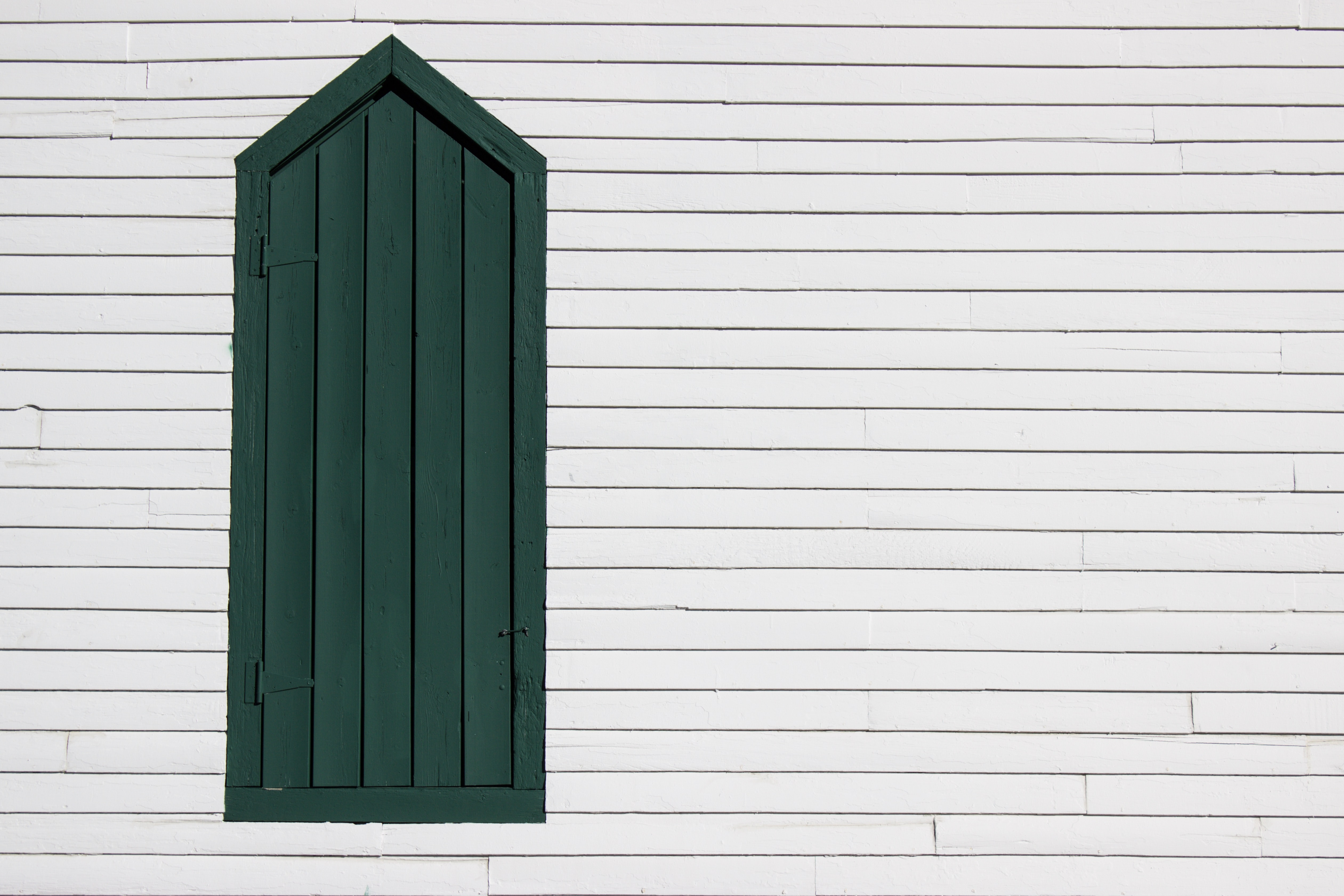 white and green wooden wall