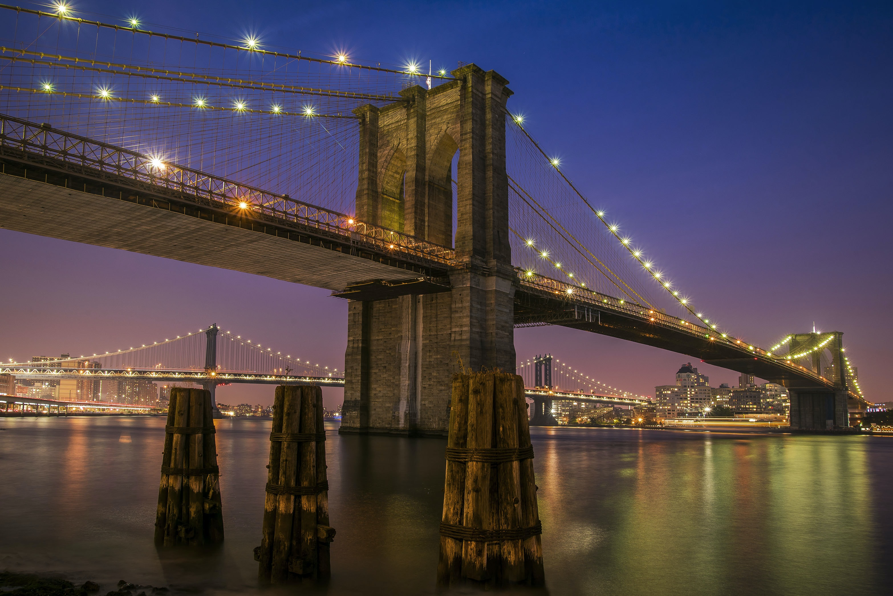 Brooklyn bridge with lights at night time