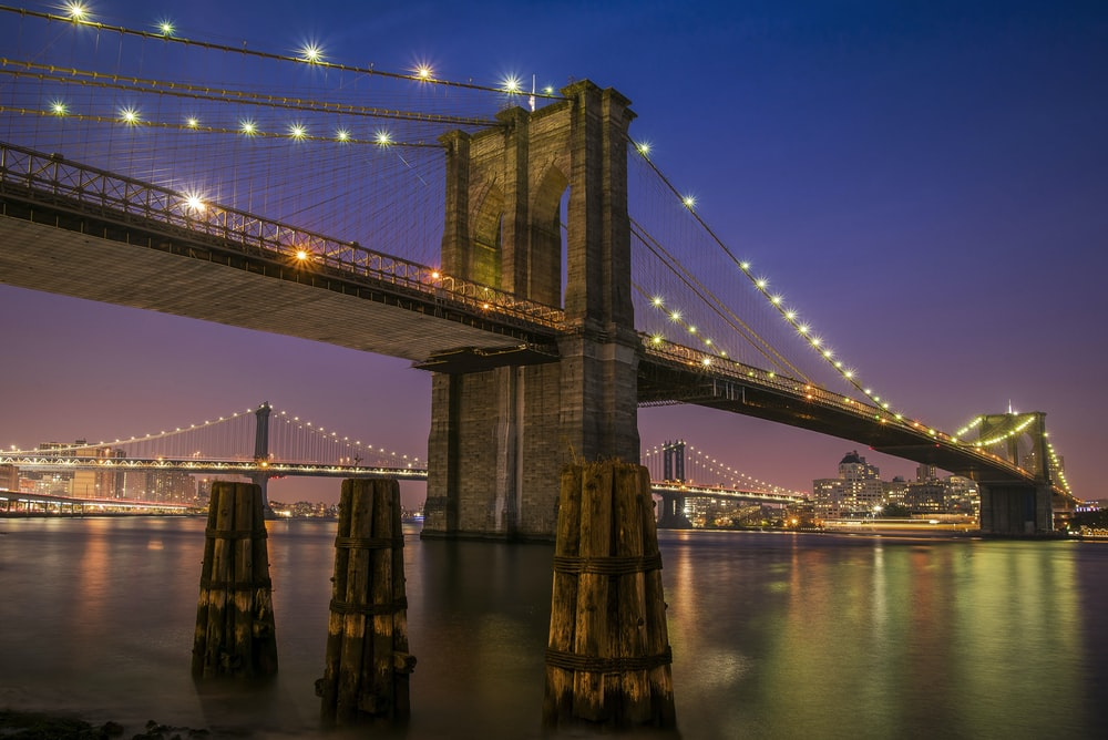 Brooklyn bridge with lights at night time