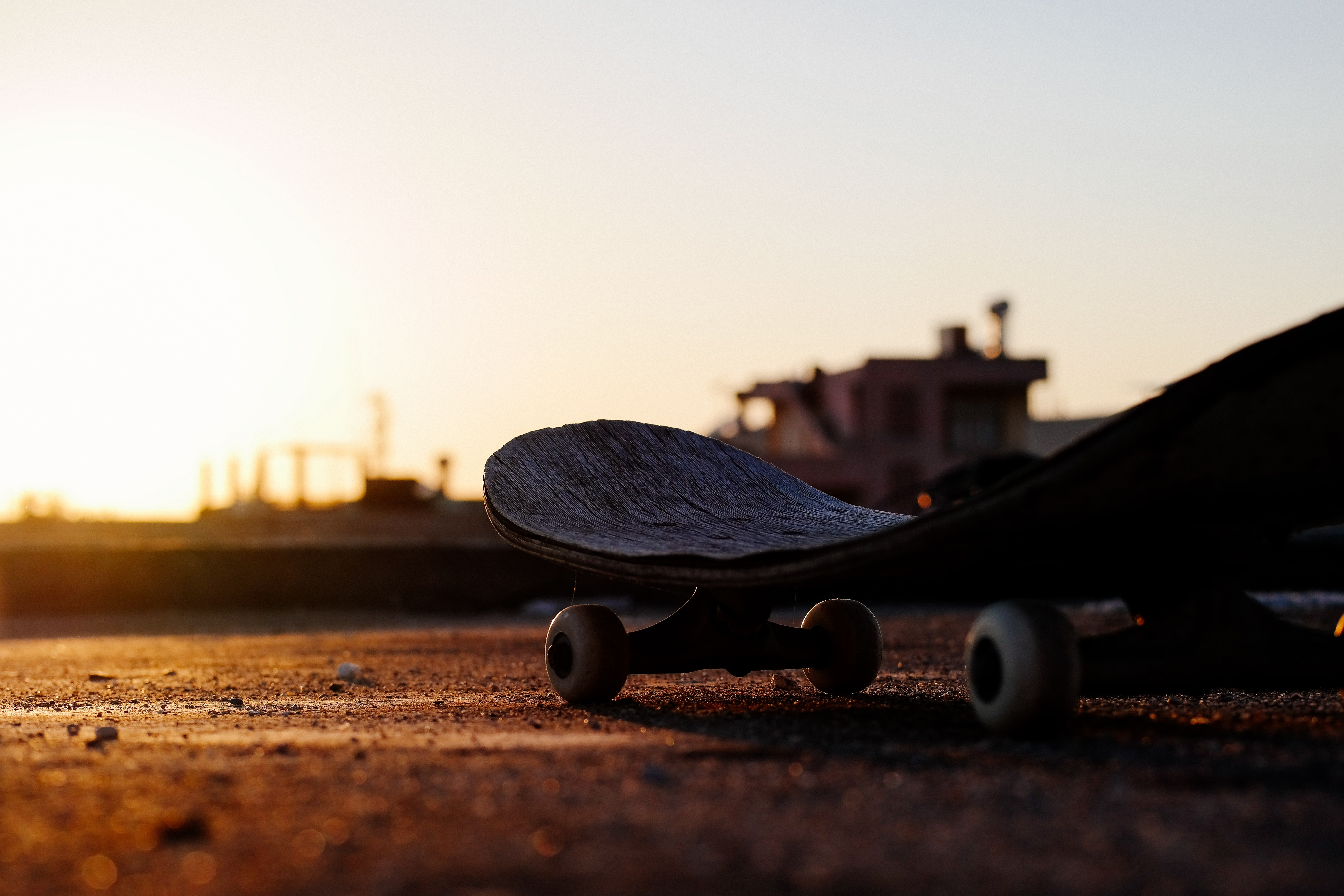 Skateboard macro shot with obscure horizon at sunrise-or-sunset in Adana