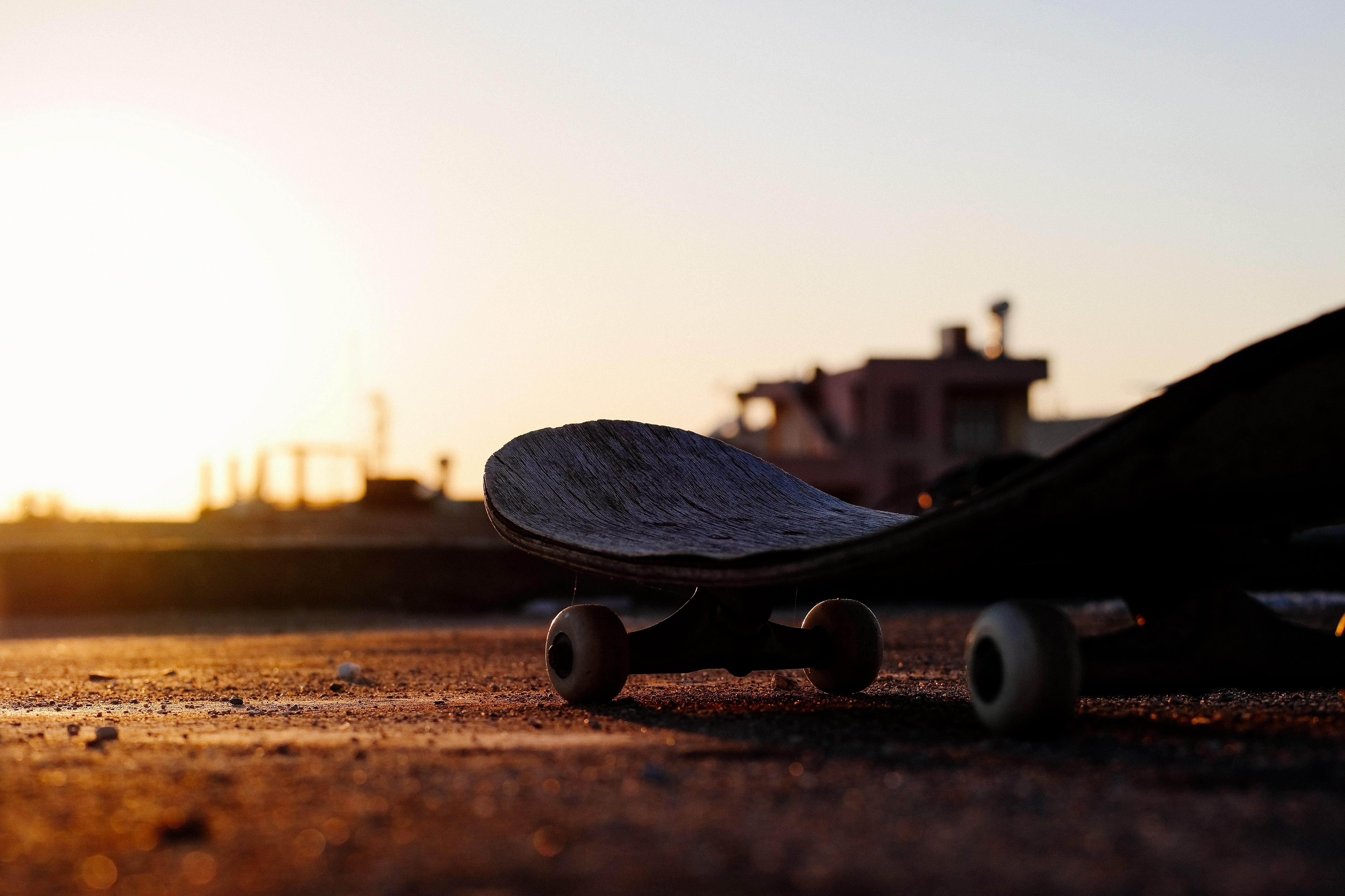 close-up photo of gray skateboard deck