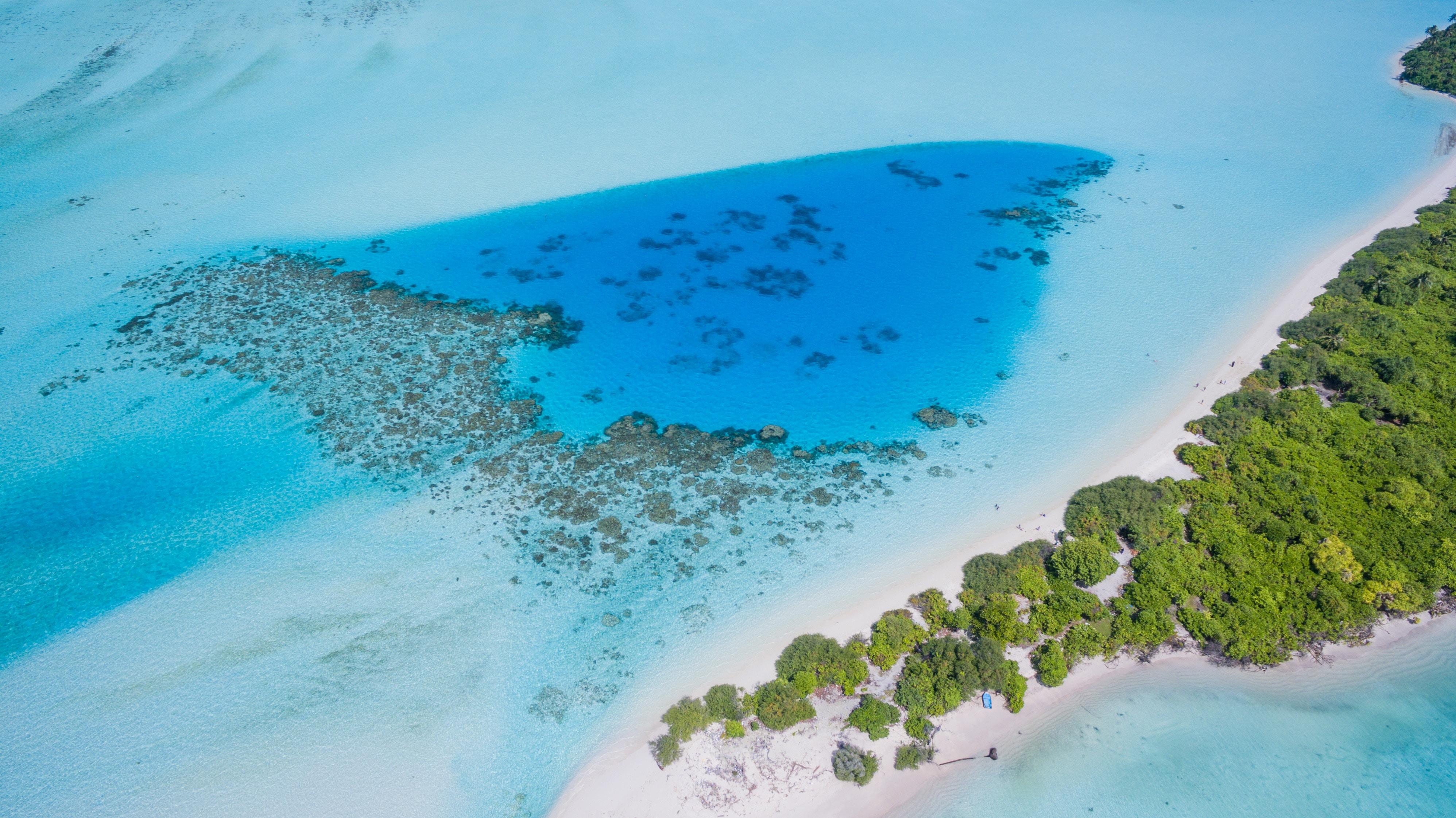 A drone shot of a tropical island in Maldives