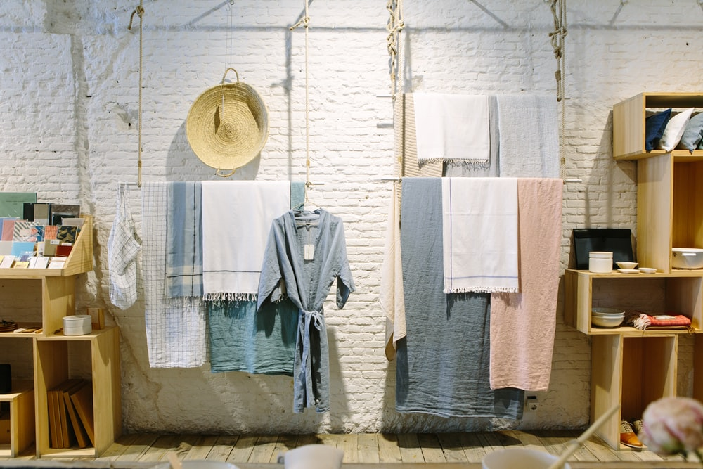 assorted-color towels hanging inside room
