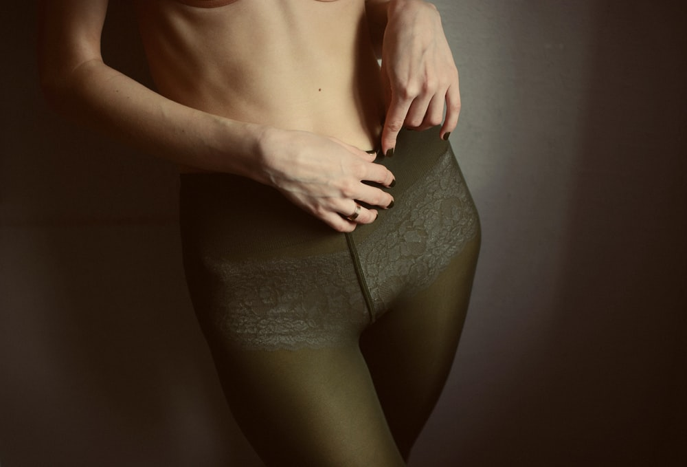 filtered photography of woman wearing fishnet leggings