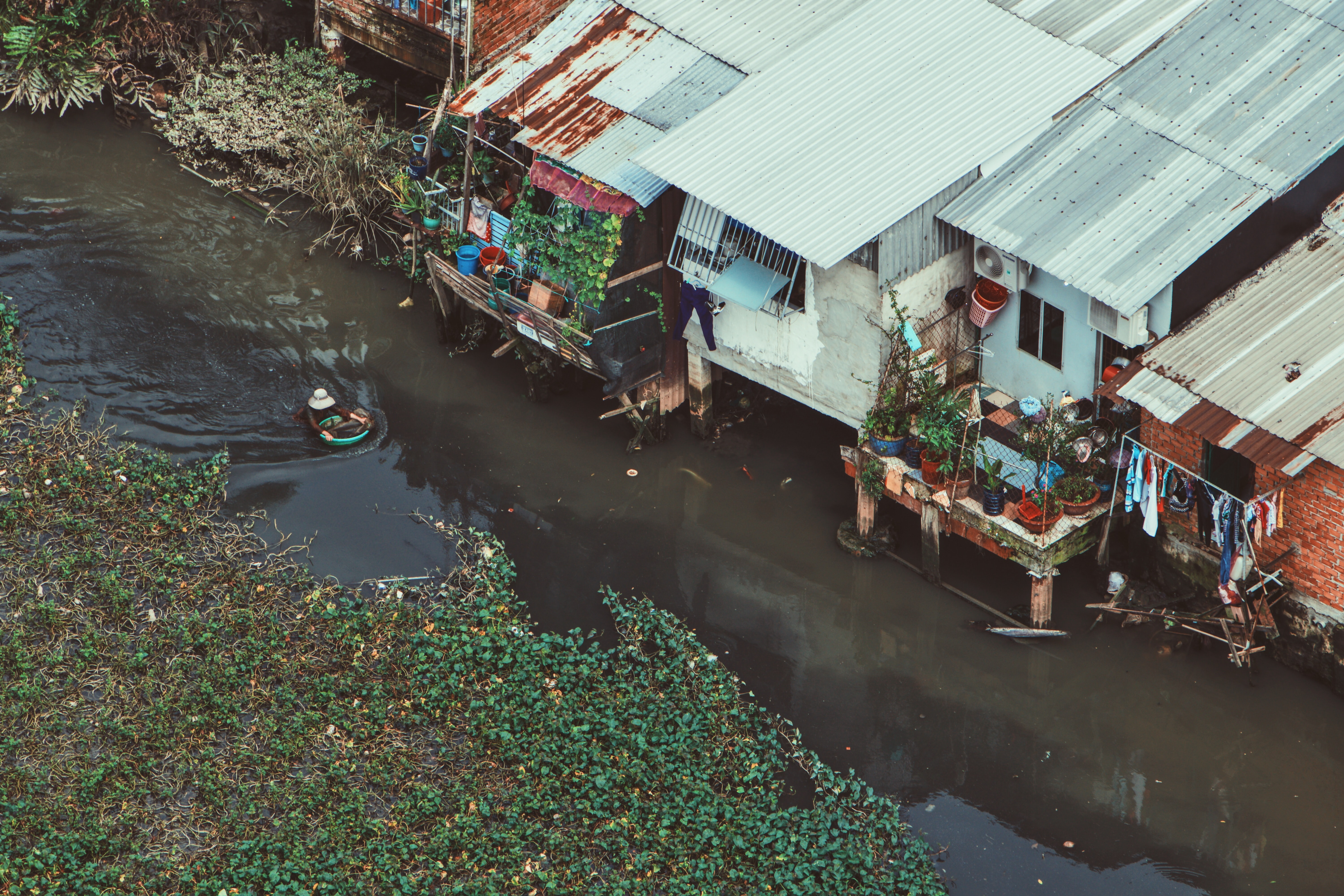 aerial photography of house beside river