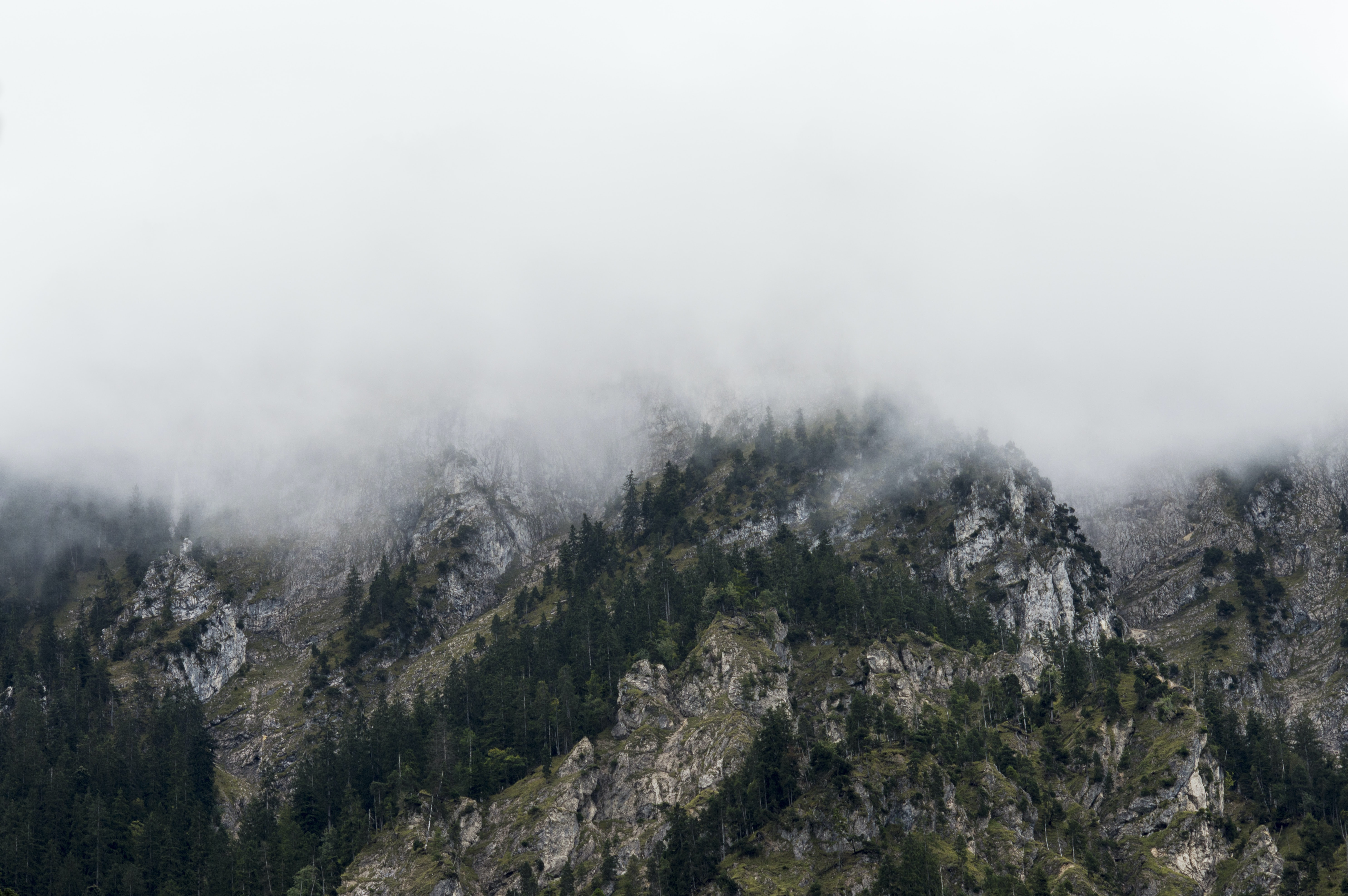 Craggy ridges covered in a thick fog in Tyrol