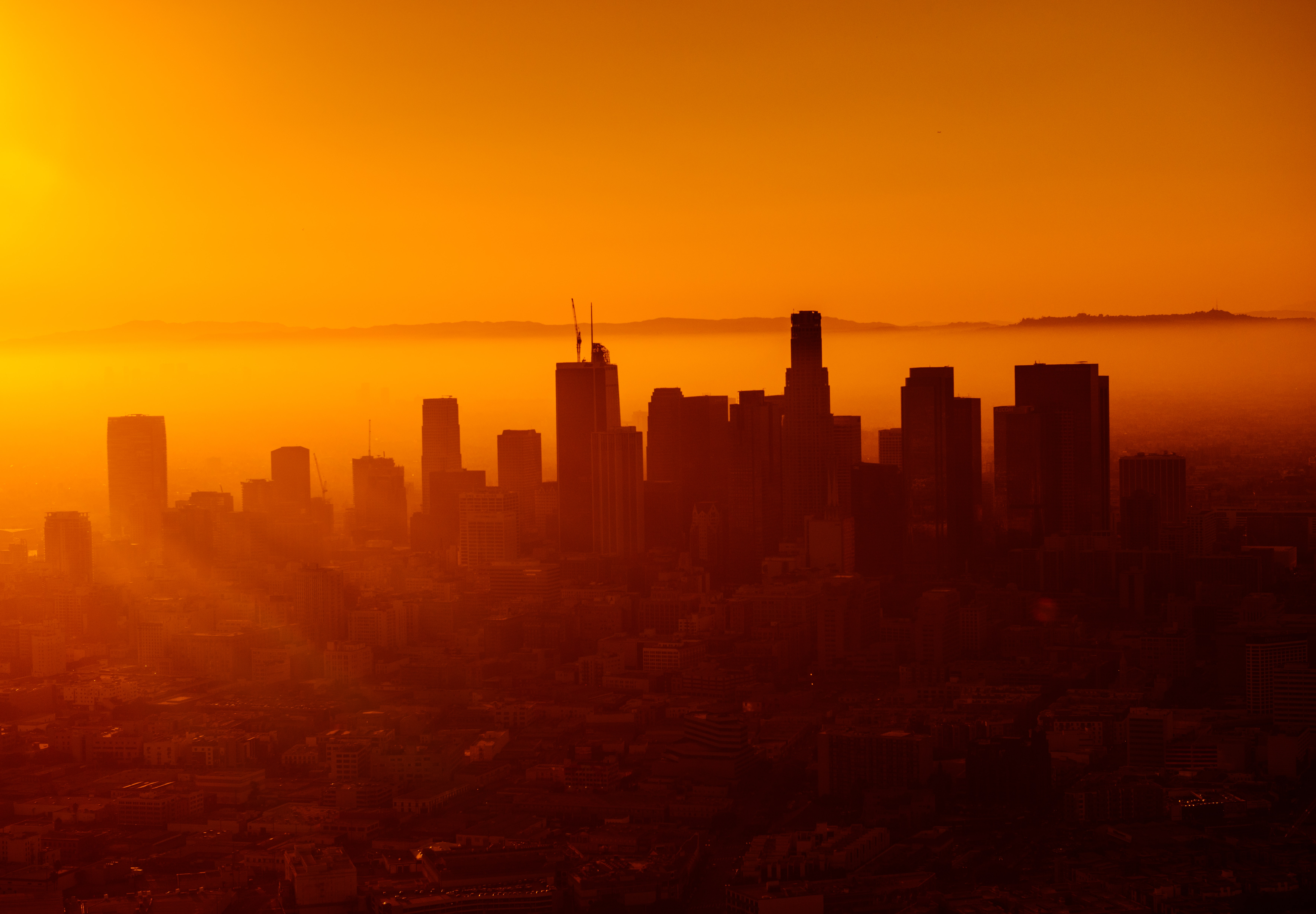 Warm orange sunset behind the skyline of Los Angeles