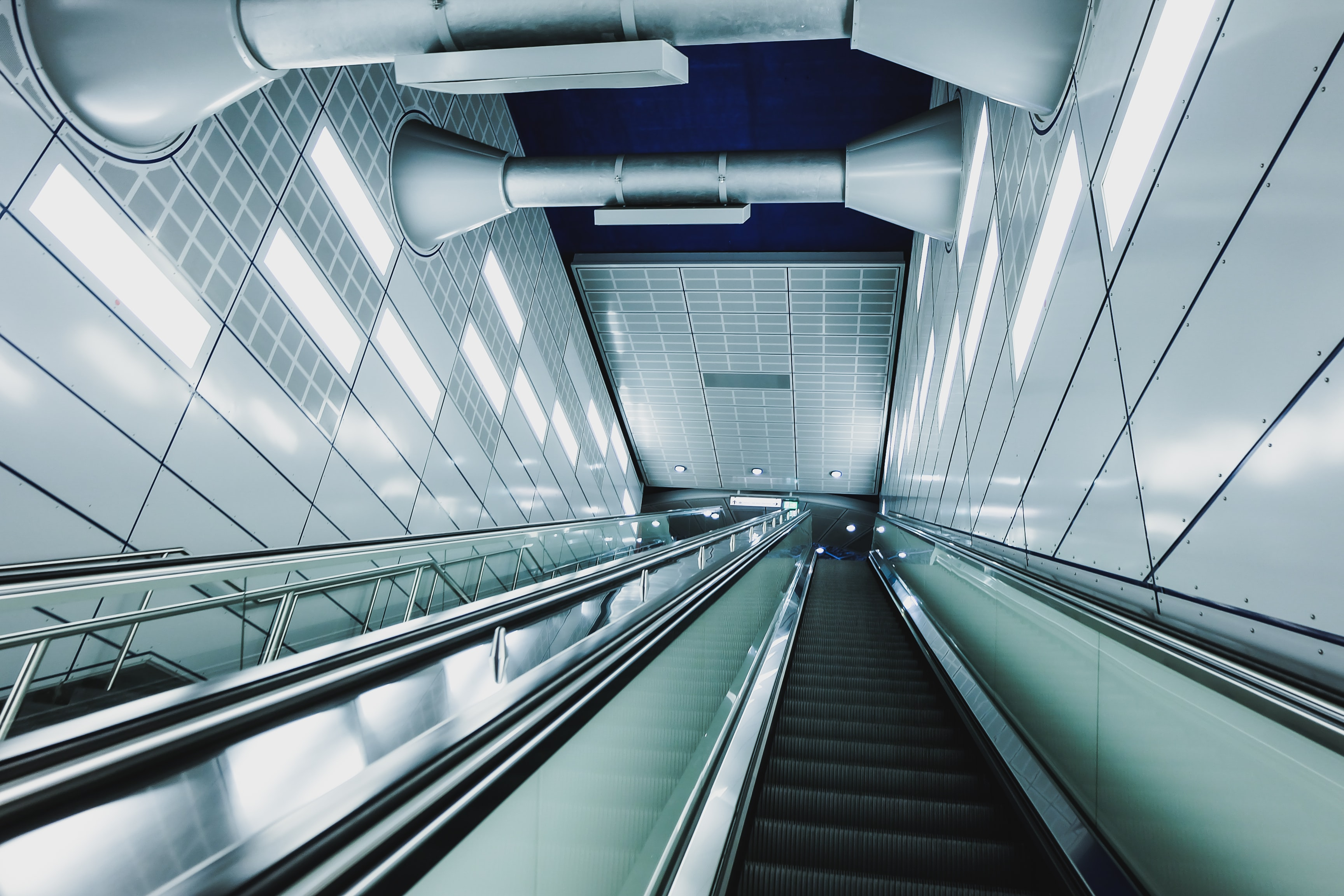 An empty staircase and an escalator at a subway station in Cologne