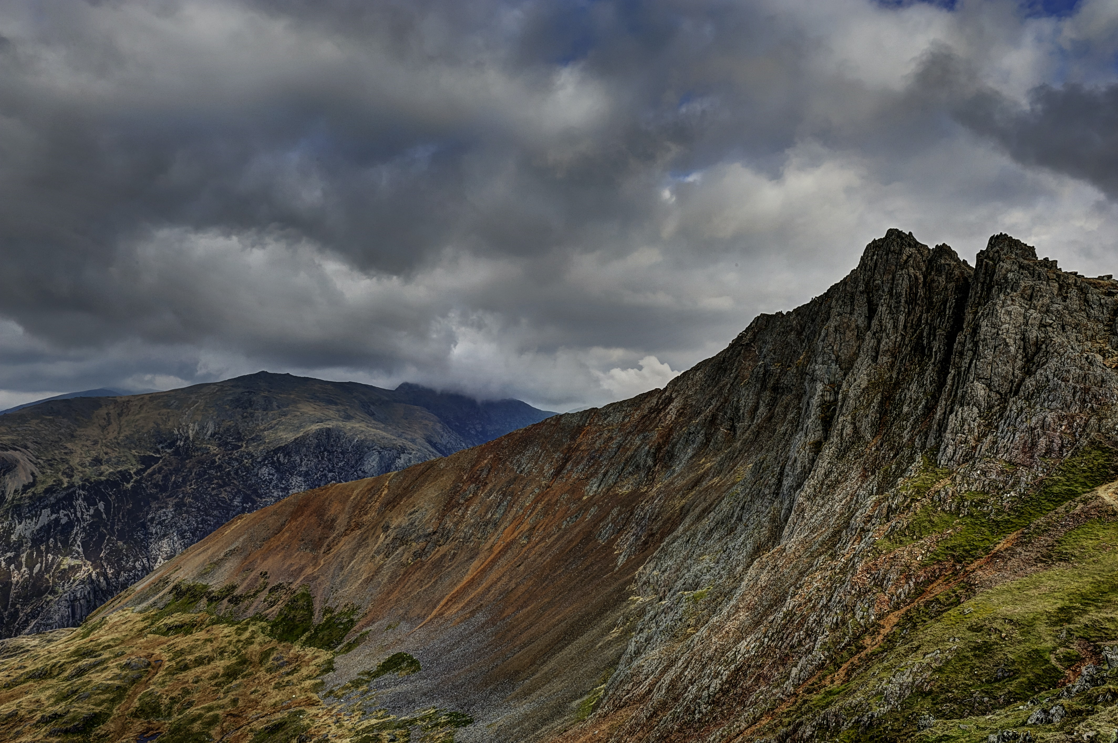 Jagged rocks and moss-covered slopes in Snowdonia National Park