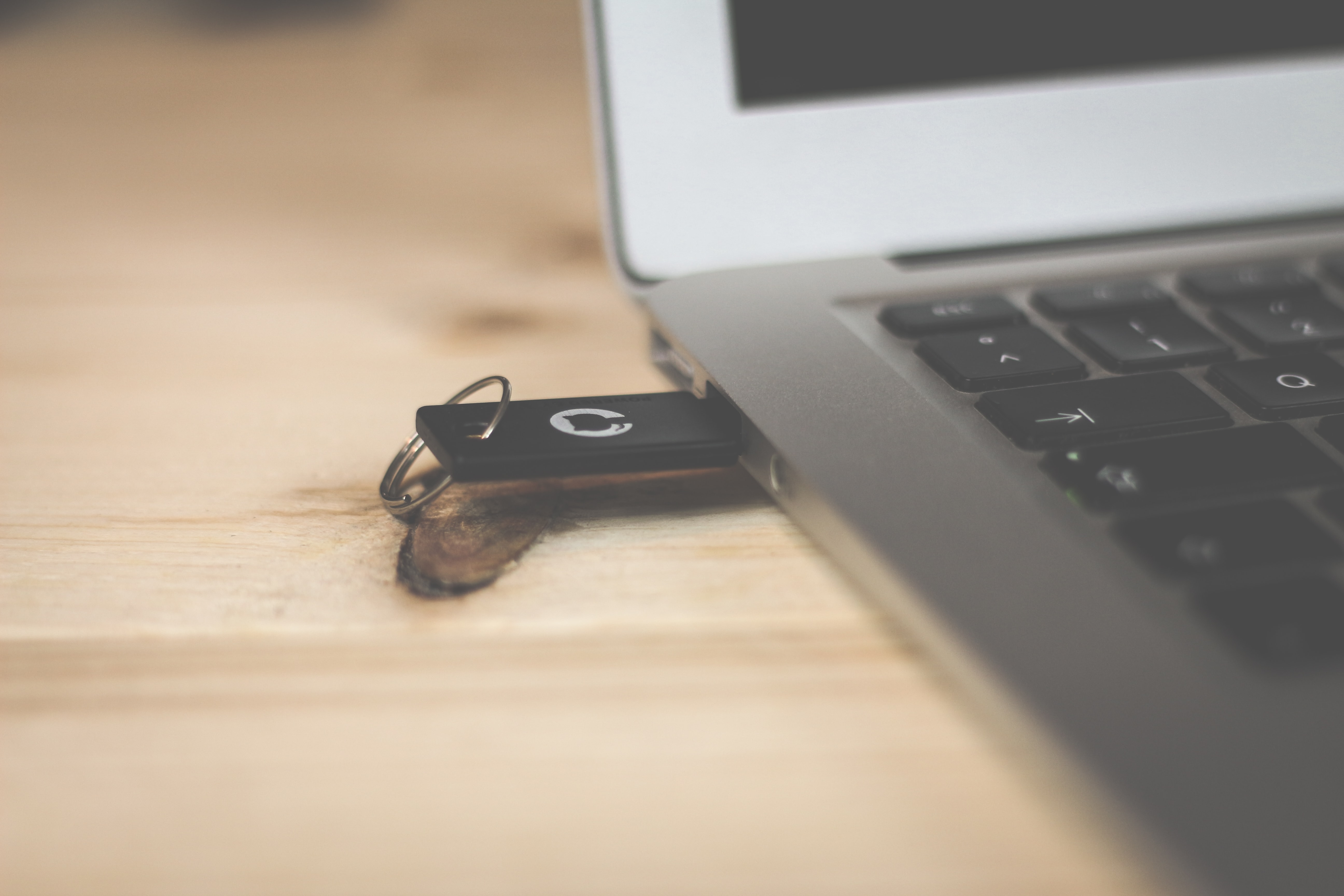 A pendrive in the USB port of a laptop