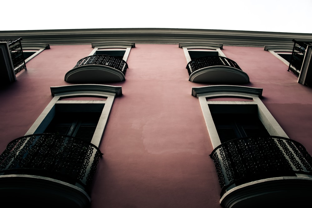 pink and white concrete building at daytime