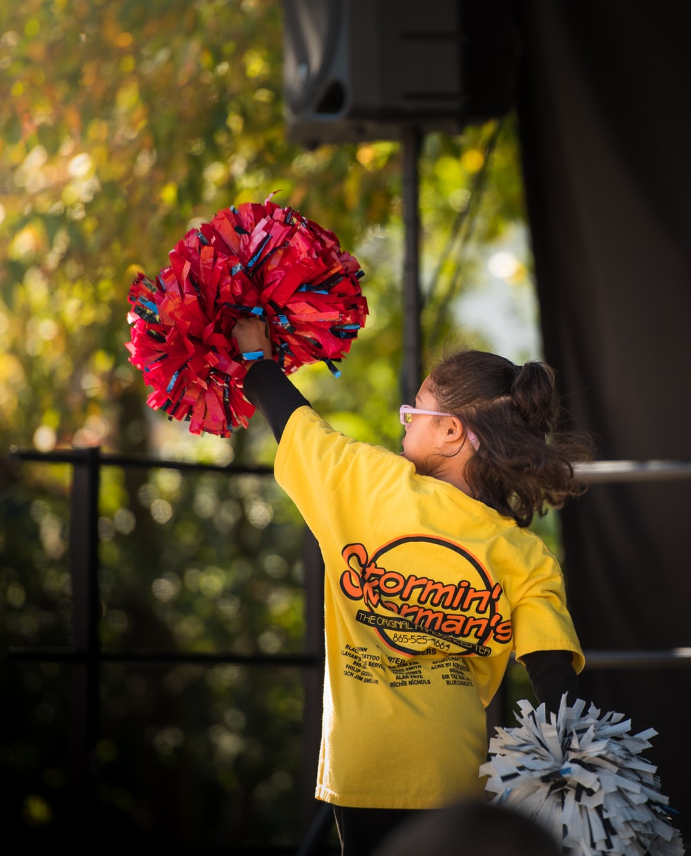 girl holding cheer dancer pompom
