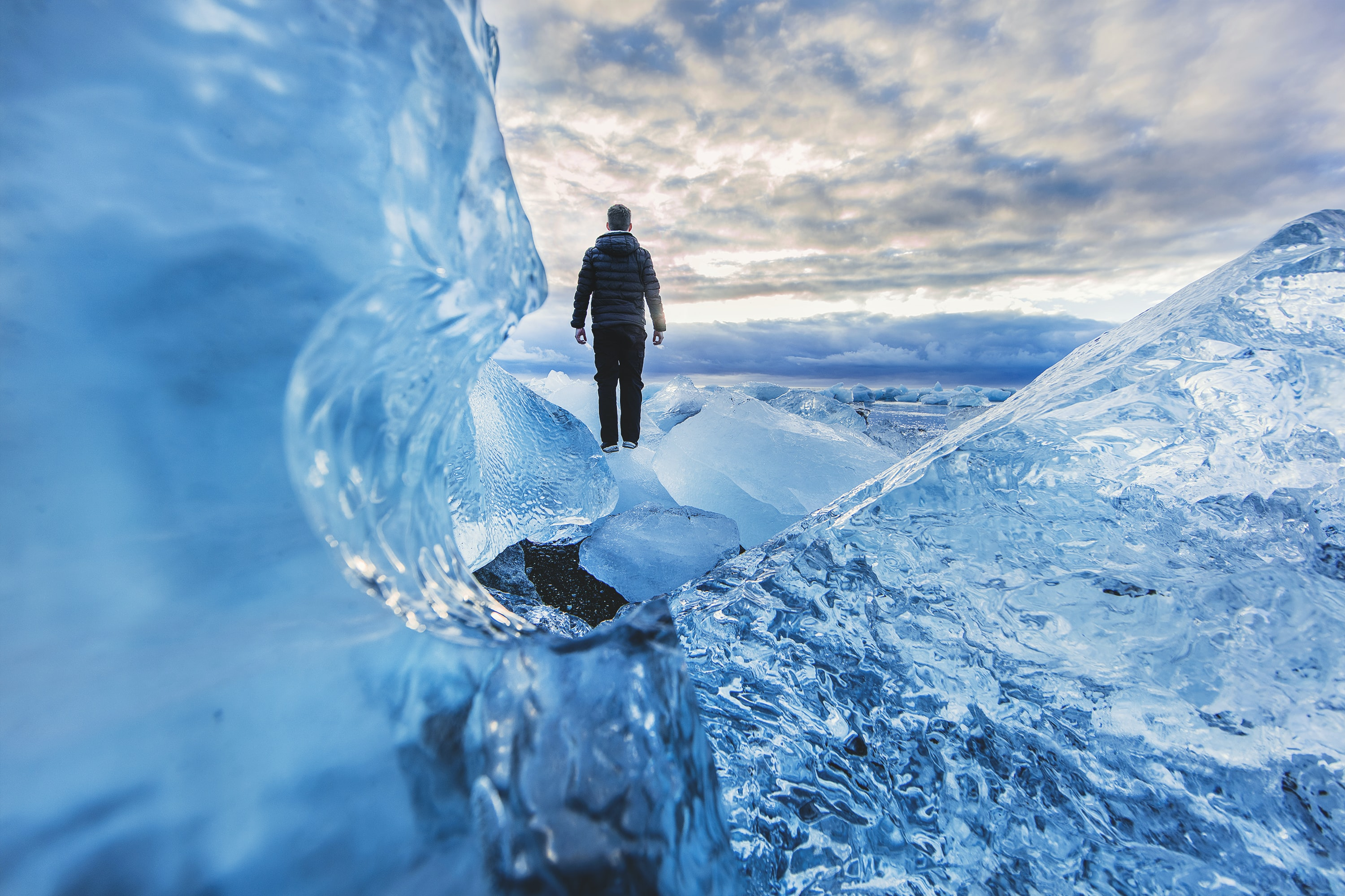 A person standing on frozen water in Jökulsárlón