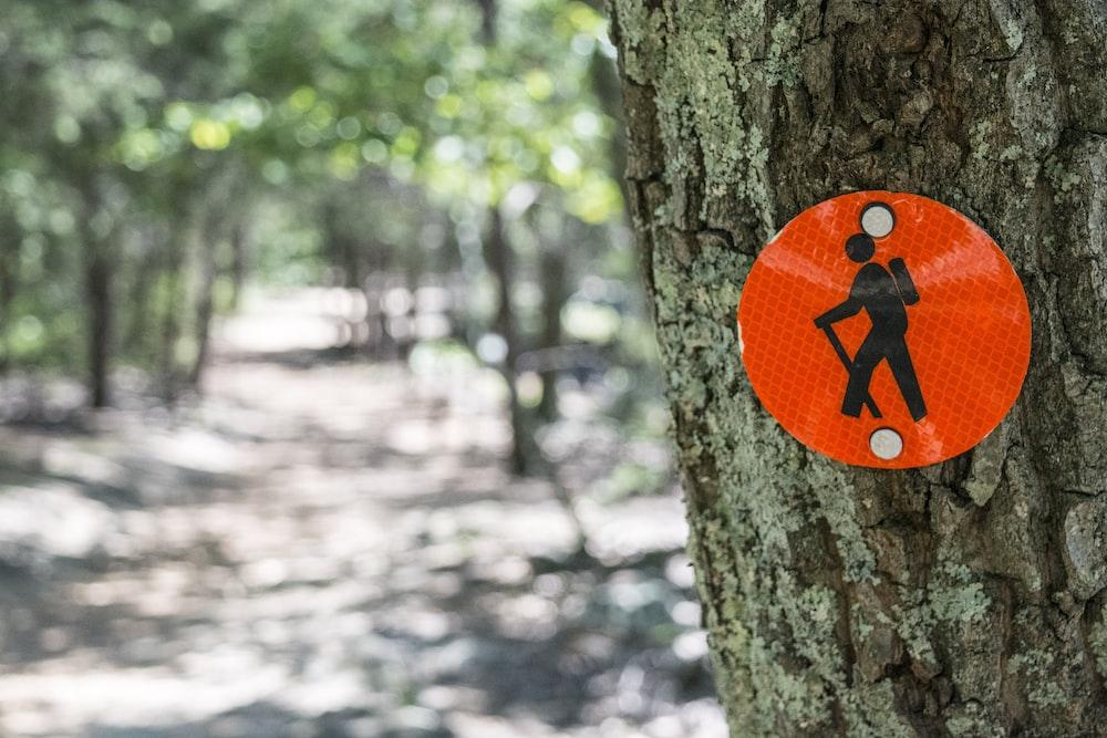 red and black signage on tree og