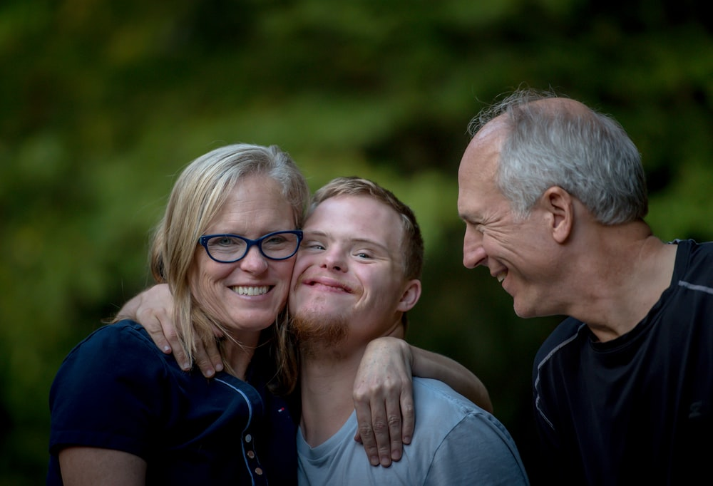 Mother, son, and father in casual shot smiling outdoors