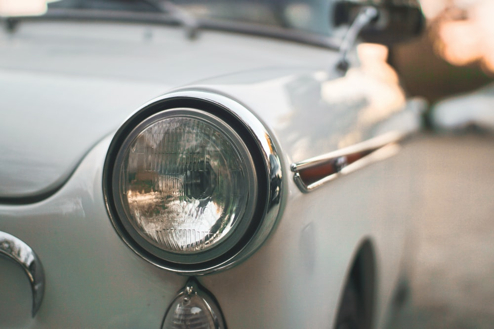 vehicle headlight close-up photography