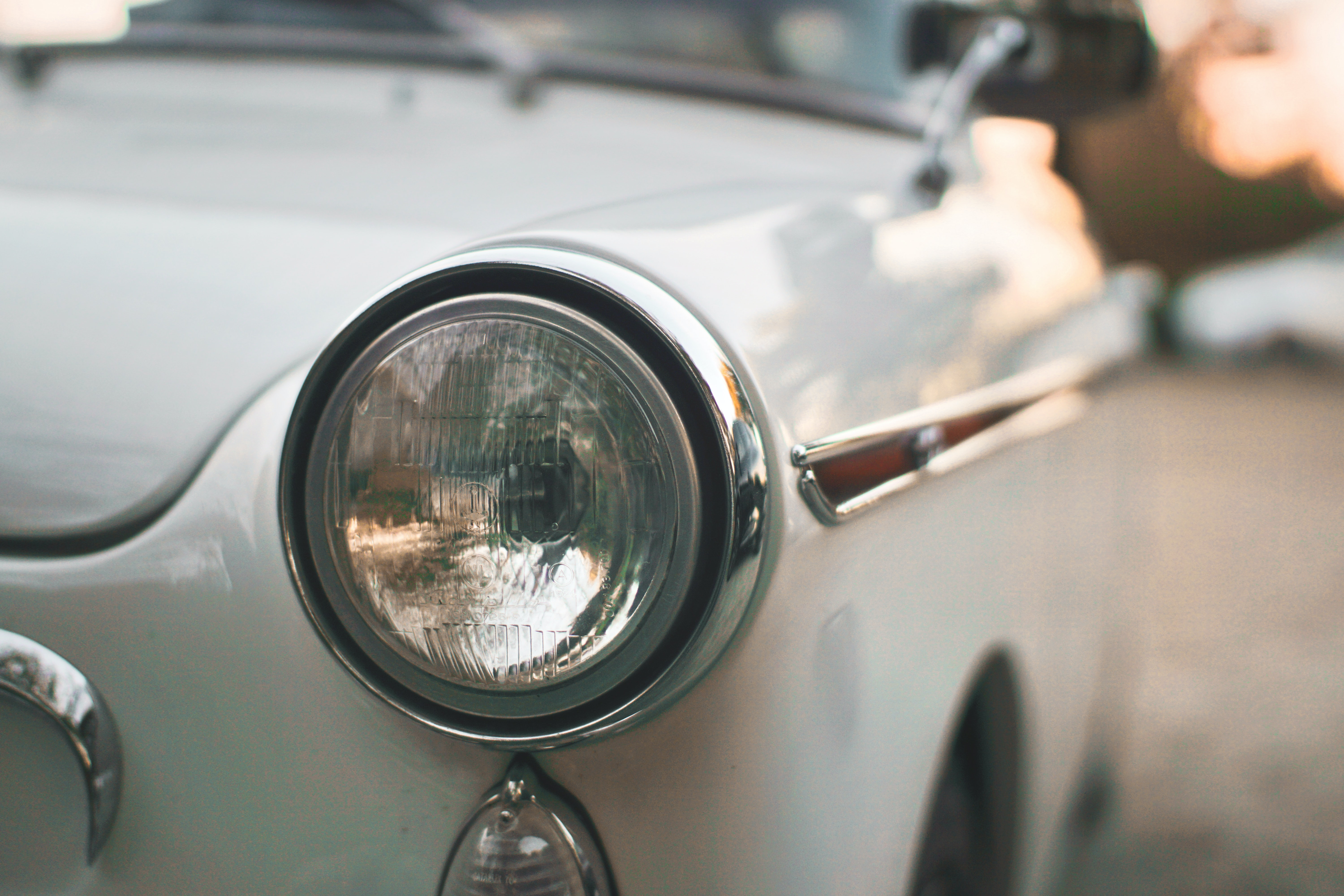 Macro shot of the white oldtimer vintage chrome headlight in Cancale