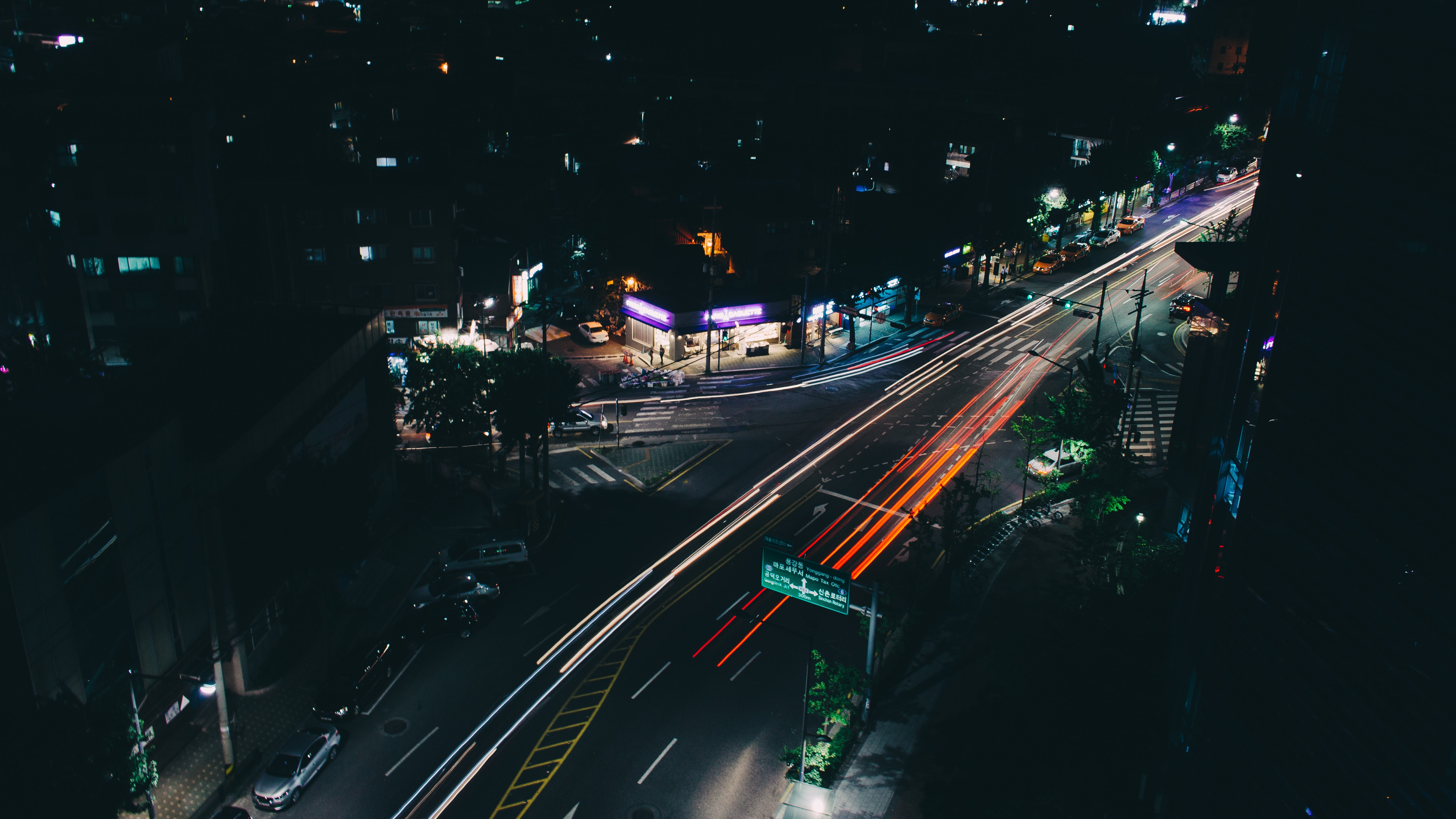 timelapse photography of vehicle passing on road at nighttime