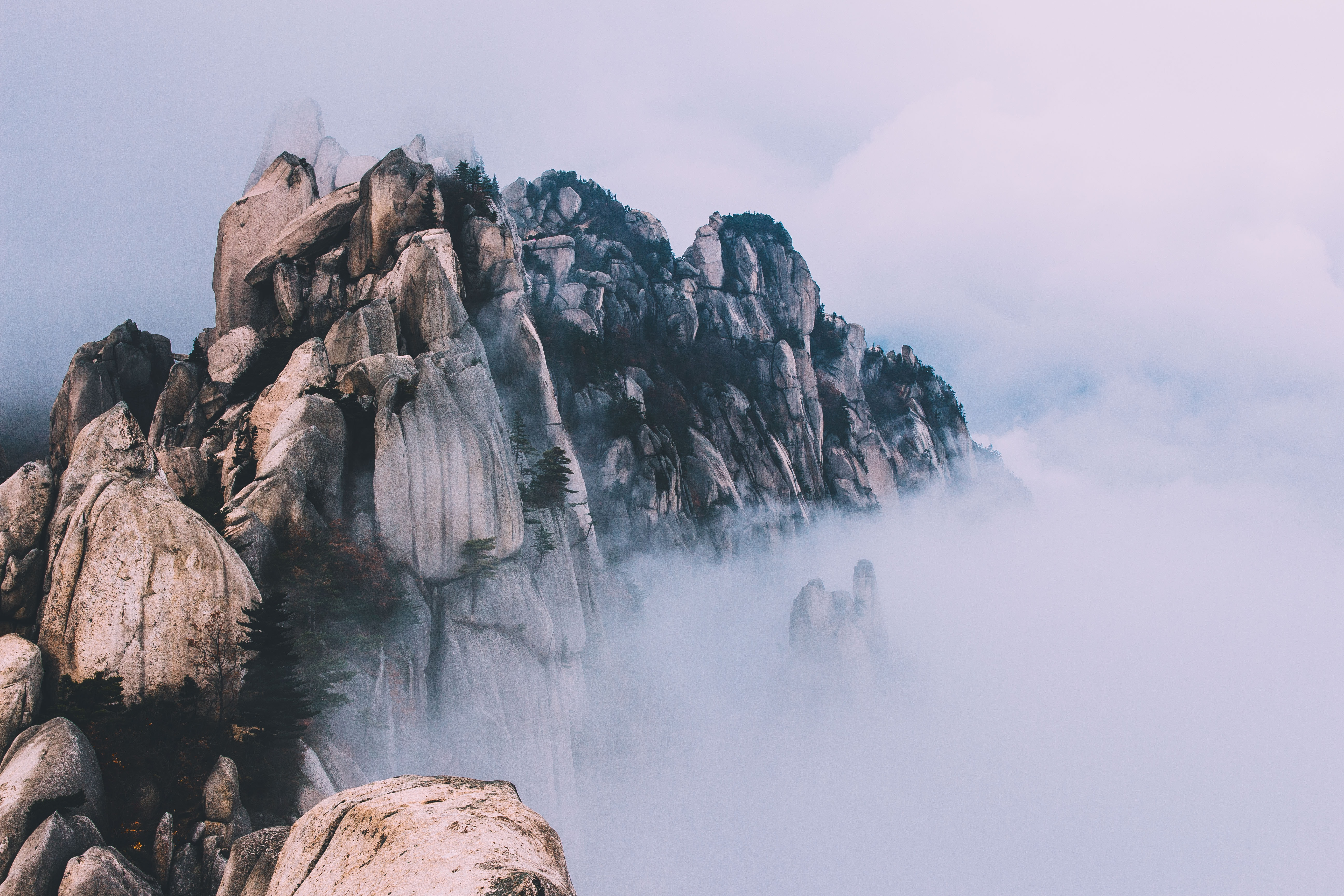rock formation surrounded with fogs