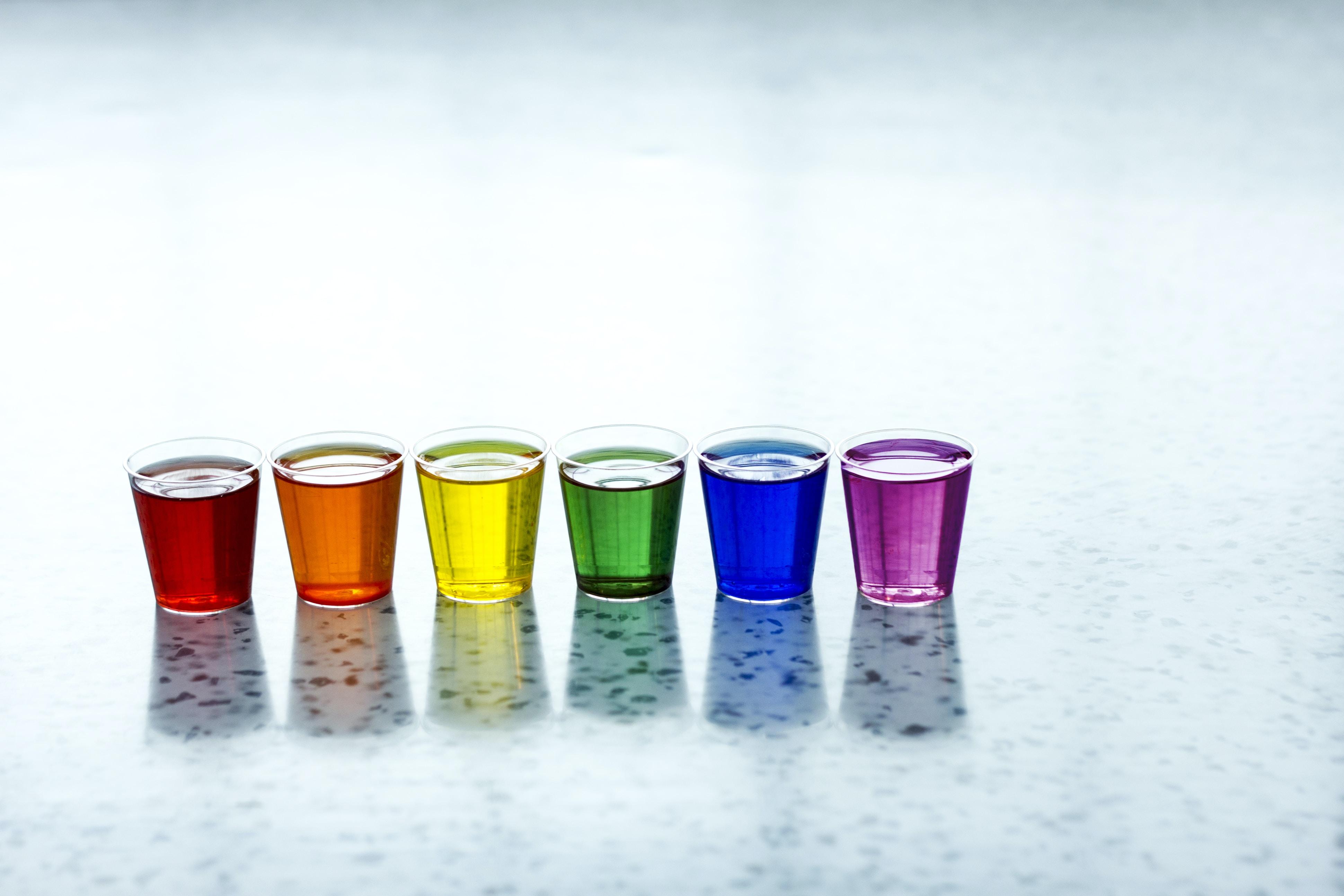 six assorted-color shot glasses