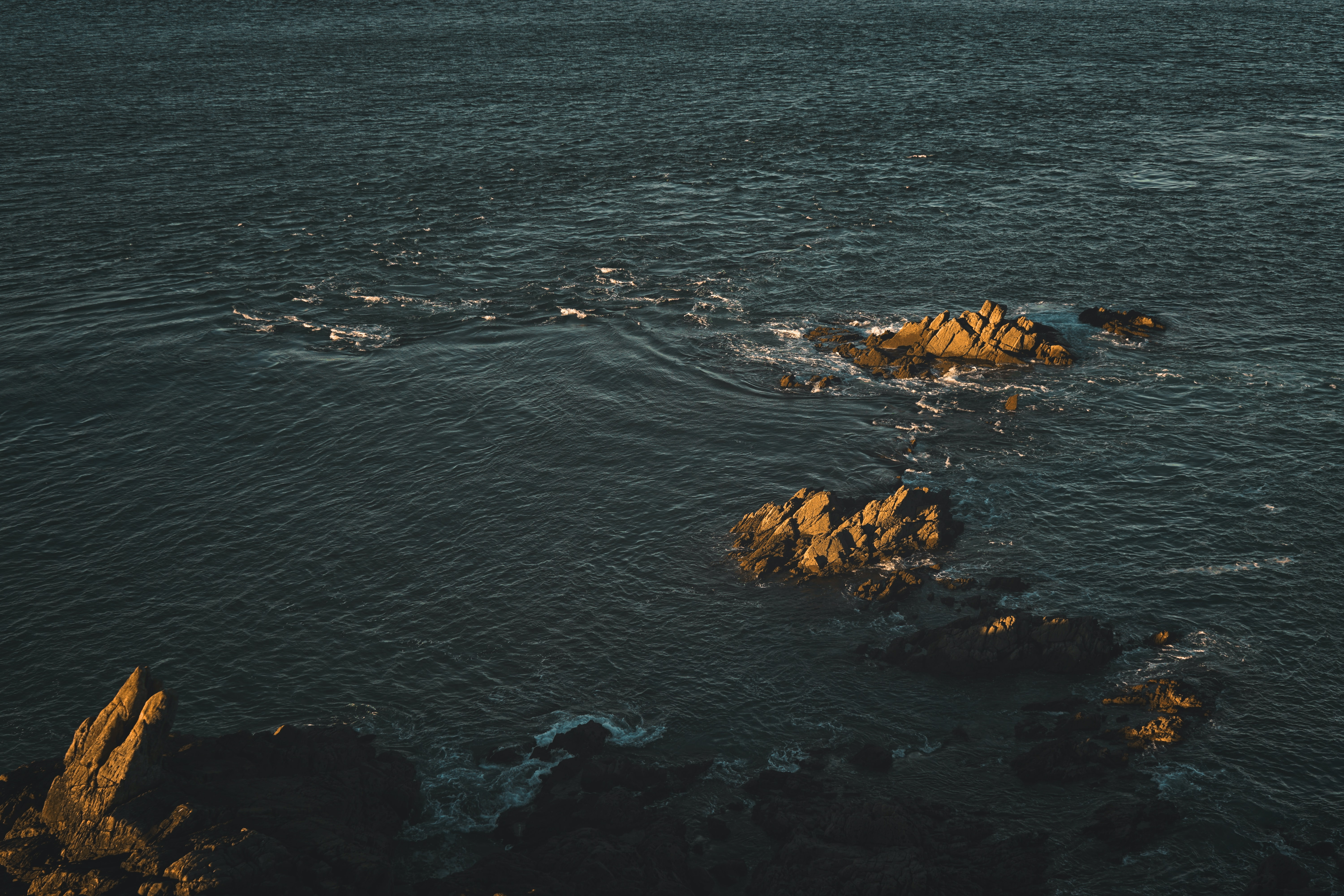 aerial photography of seashore near rock