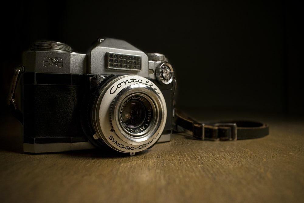 closeup photography of gray and black camera on table