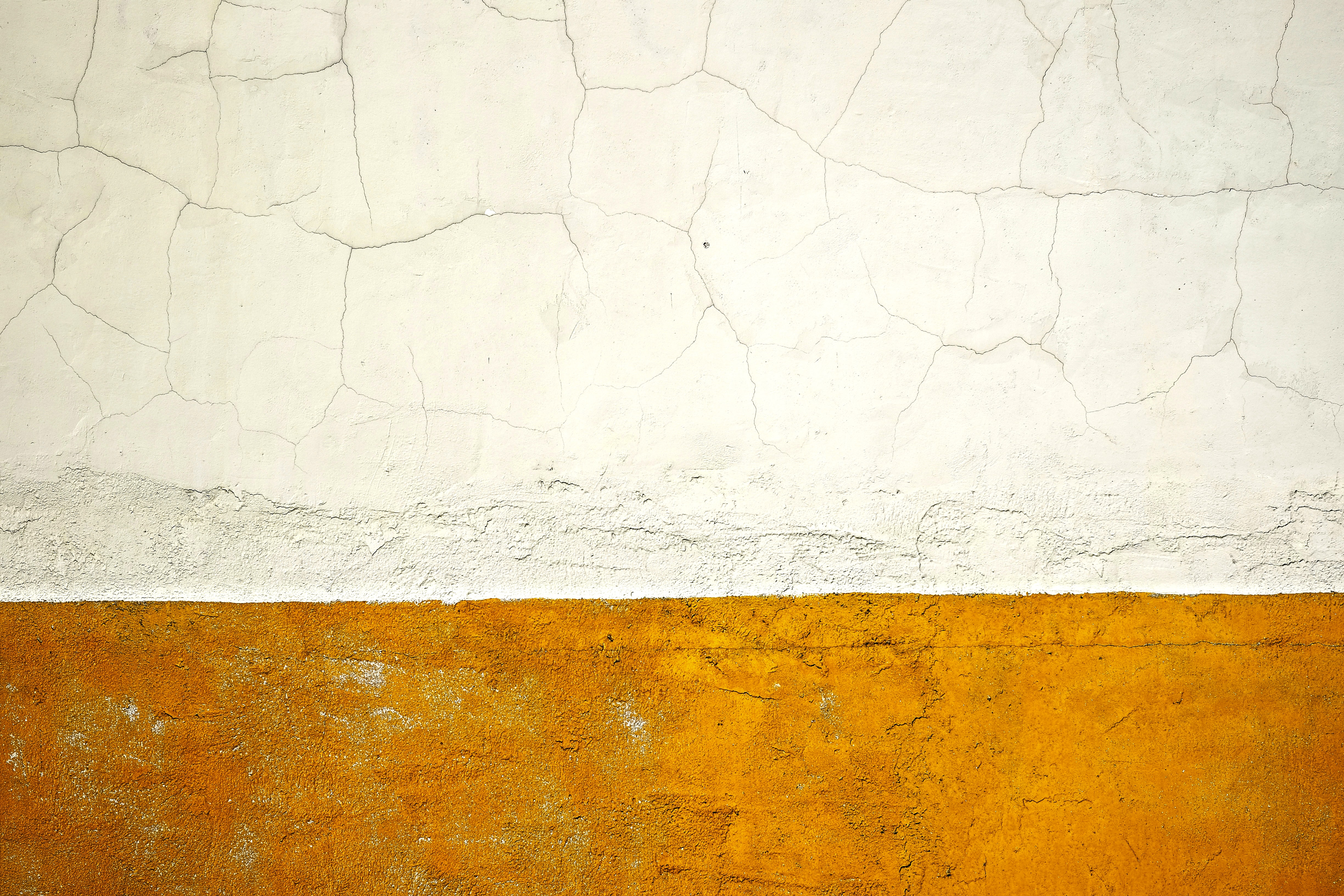 A cracked wall texture background pattern, taken in Grotle