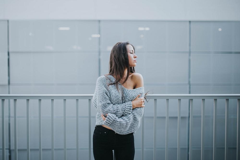woman in gray sweater