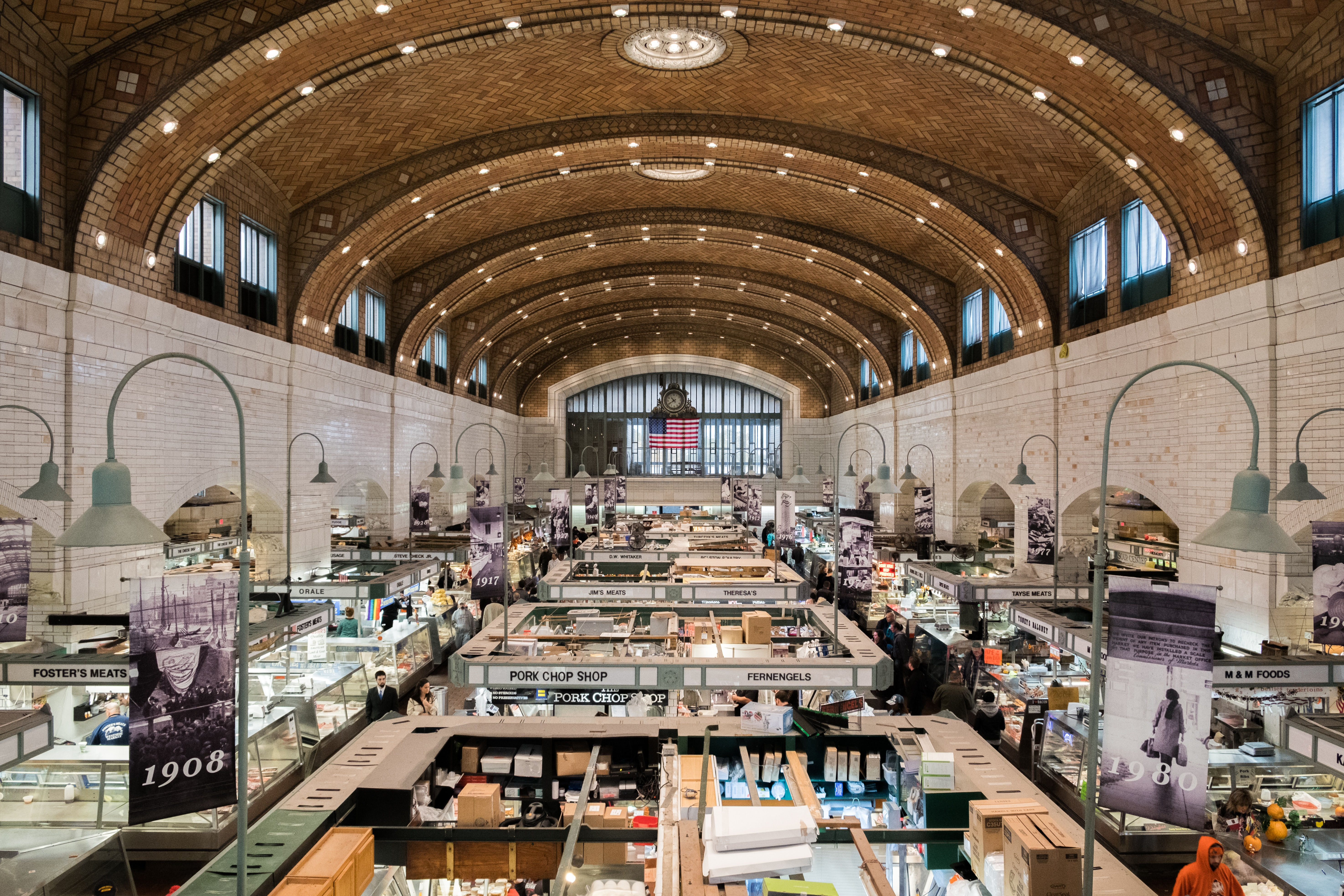 Inside an ornate food market with produce vendors