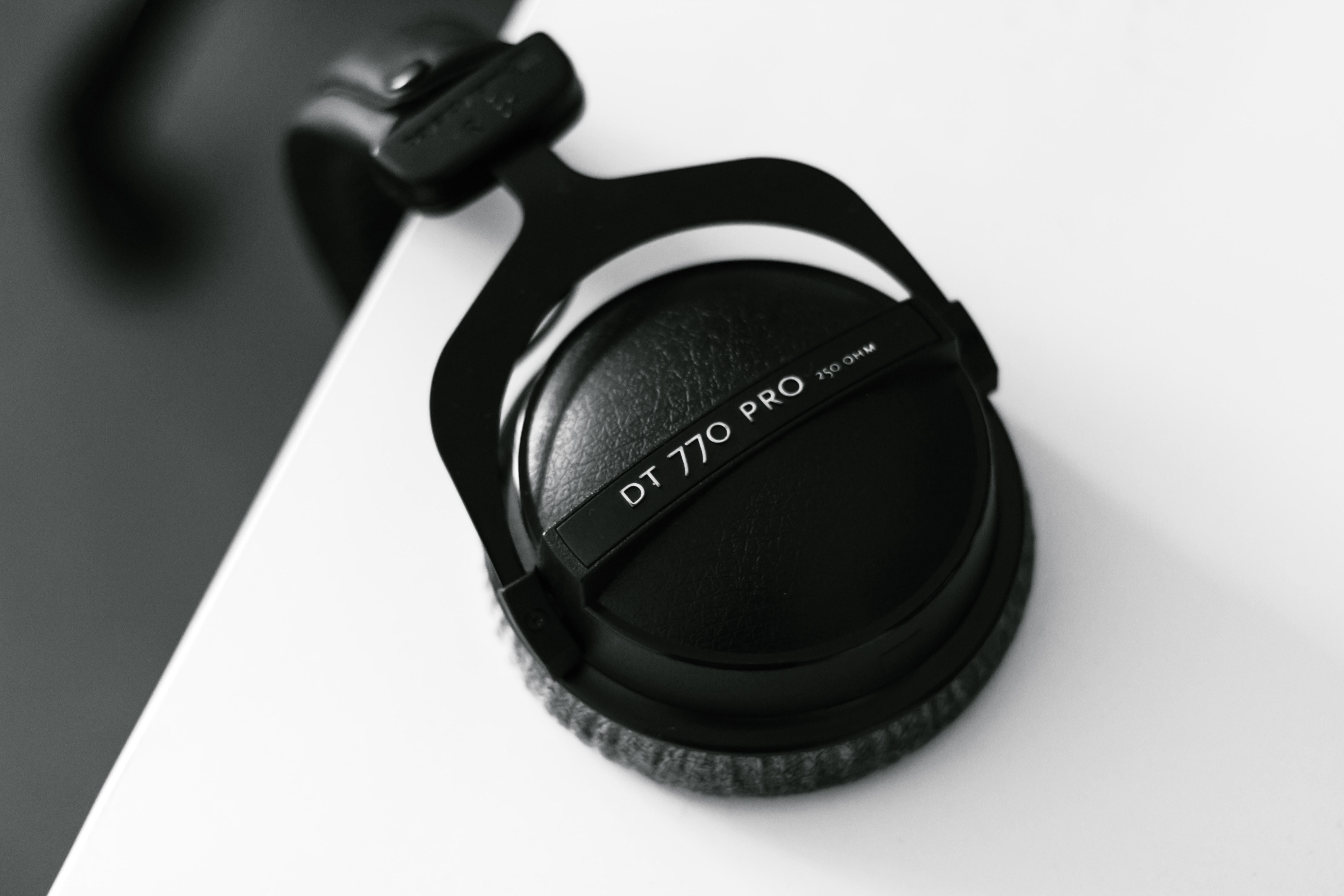 black DT 770 Pro headphones on white surface