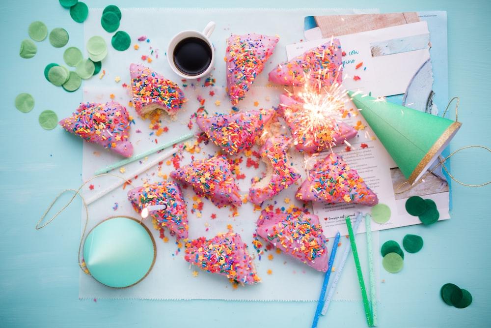 green paper cone near slice cakes