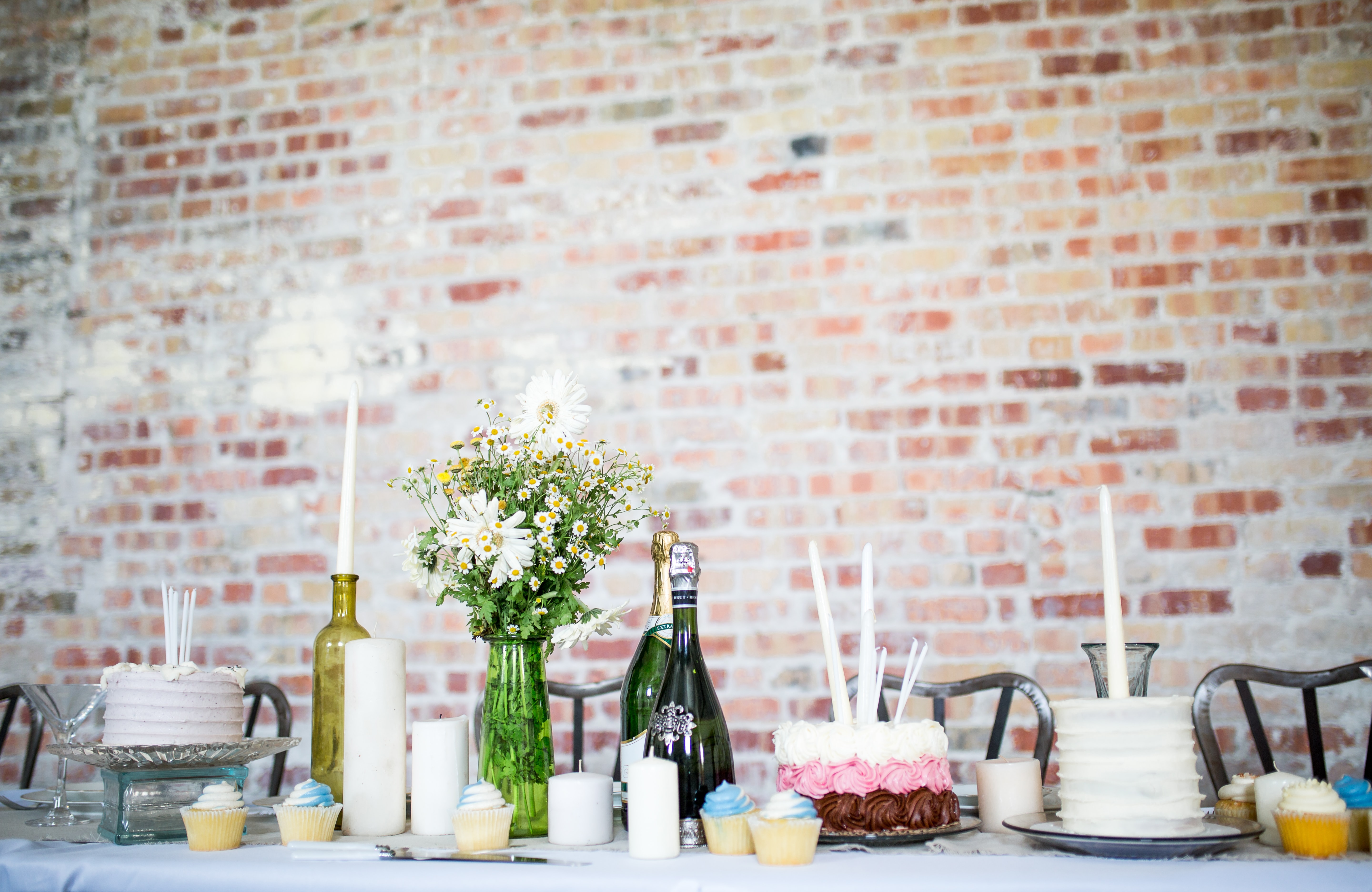 cake beside candles and flowers