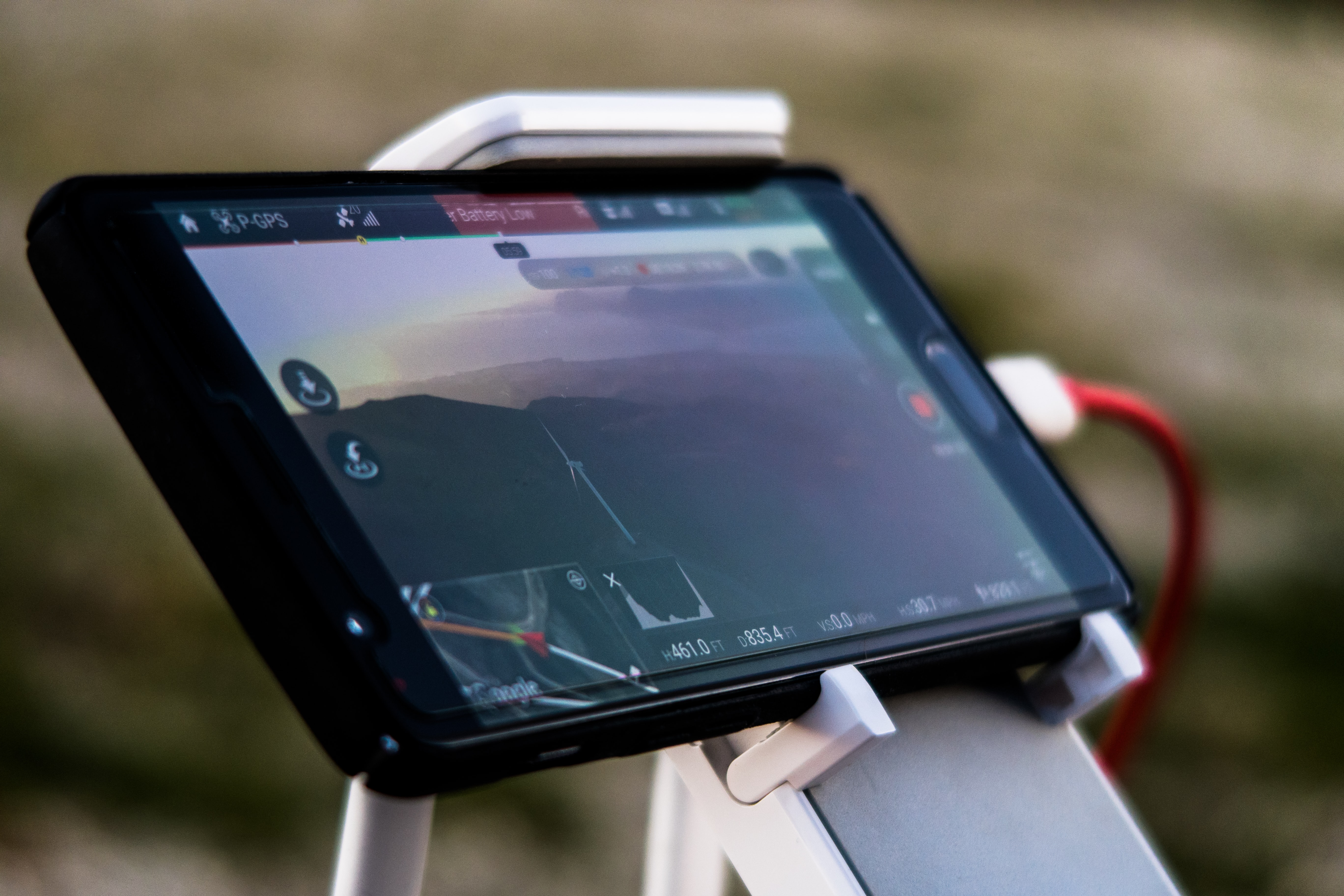 A close-up of a smartphone in a stand used as a car GPS system