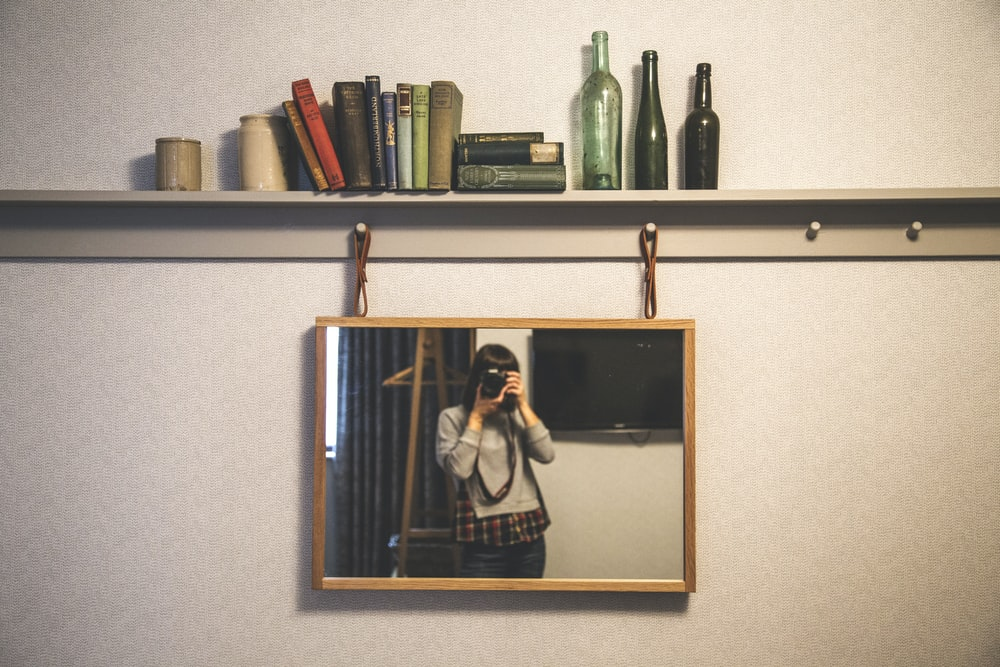 woman taking photography in front of the mirror