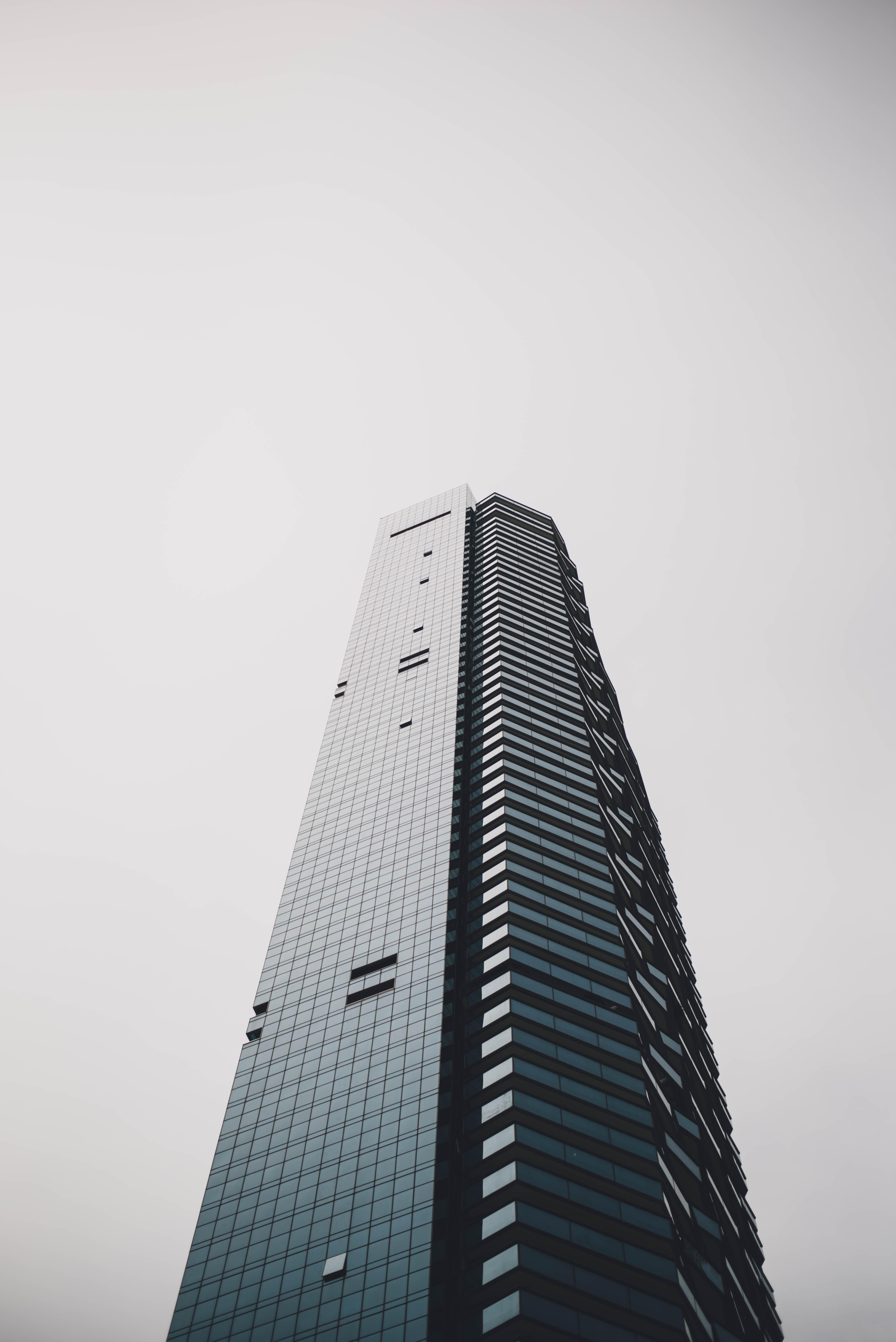 A tall skyscraper with a black glass facade