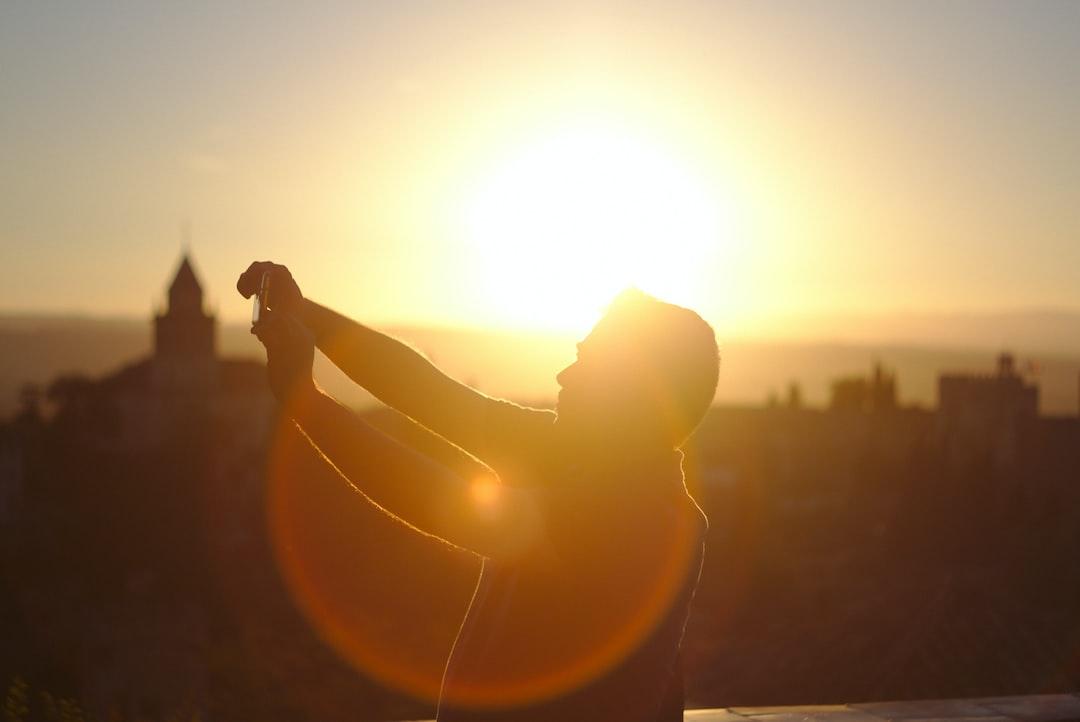 man taking backlit selfie